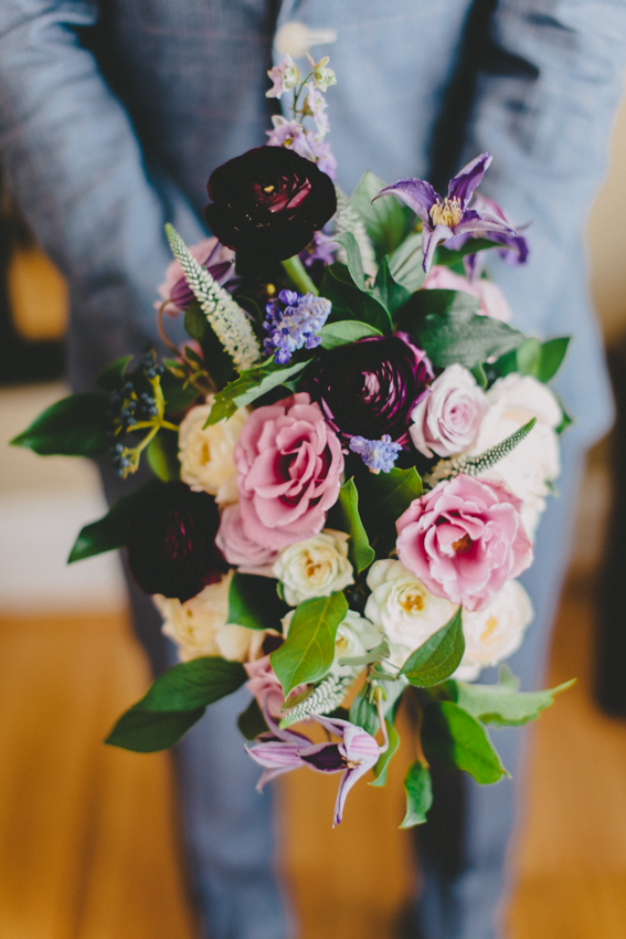 Purple bouquet of roses sand ranunculus by Wild Green Yonder - DC Wedding Florist