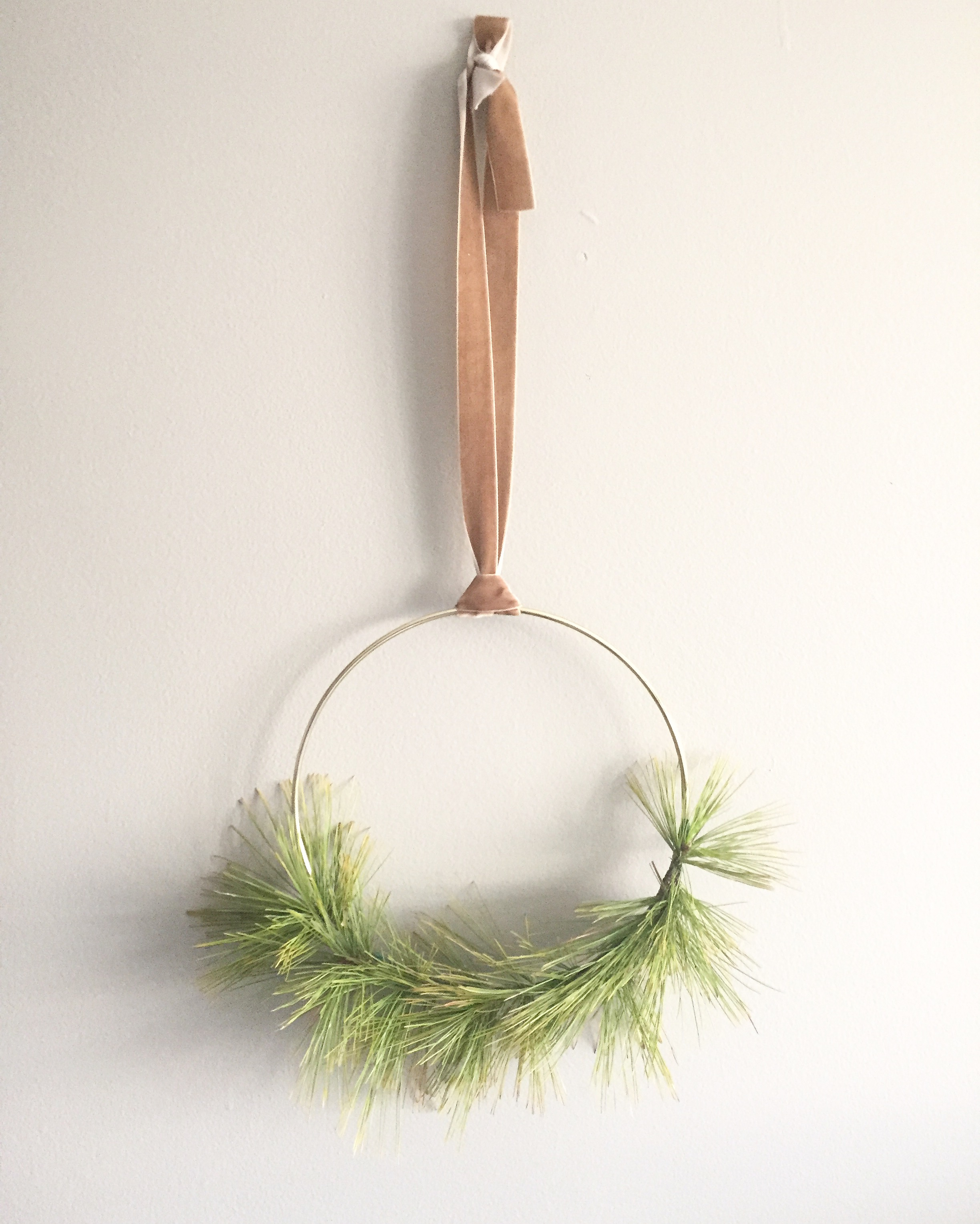 Modern Wreath with pine, brass, and velvet by Wild Green Yonder