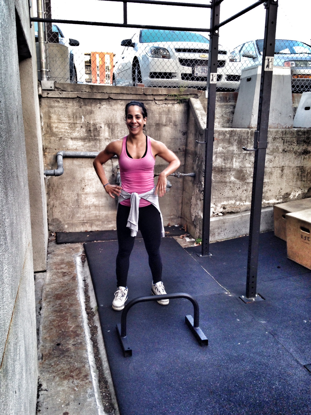 Enaz.  Who smiles before bar facing burpees?     This girl!   Photo by Rafael Vega