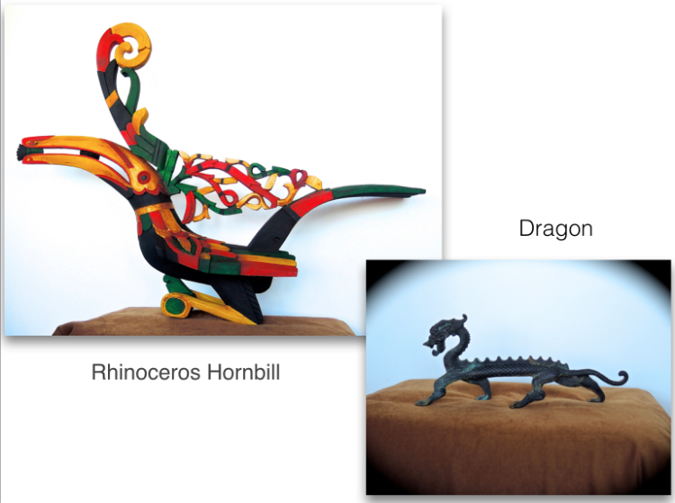 The Hornbill is both an important bird and cultural symbol for the people of Sarawak especially the Dayak communities. The Rhinoceros hornbill the best known of all the species, is the State's emblem. For the Dayaks, male hornbills signify the spirit of God and they must be treated with respect. Hornbill elements are incorporated into their arts, dances, carvings, and ceremonial dresses. This hornbill (Kenyalang) was carved by Tutu anak Ragu, the headman of Rumah Tuntun Longhouse.                                                        The Dragon symbolizes strength, health, harmony intellect, wisdom and is seen as female. She is a grounding force.    These are the symbols of Malaysia I brought back from Kuching. They now reign supreme in my living room.