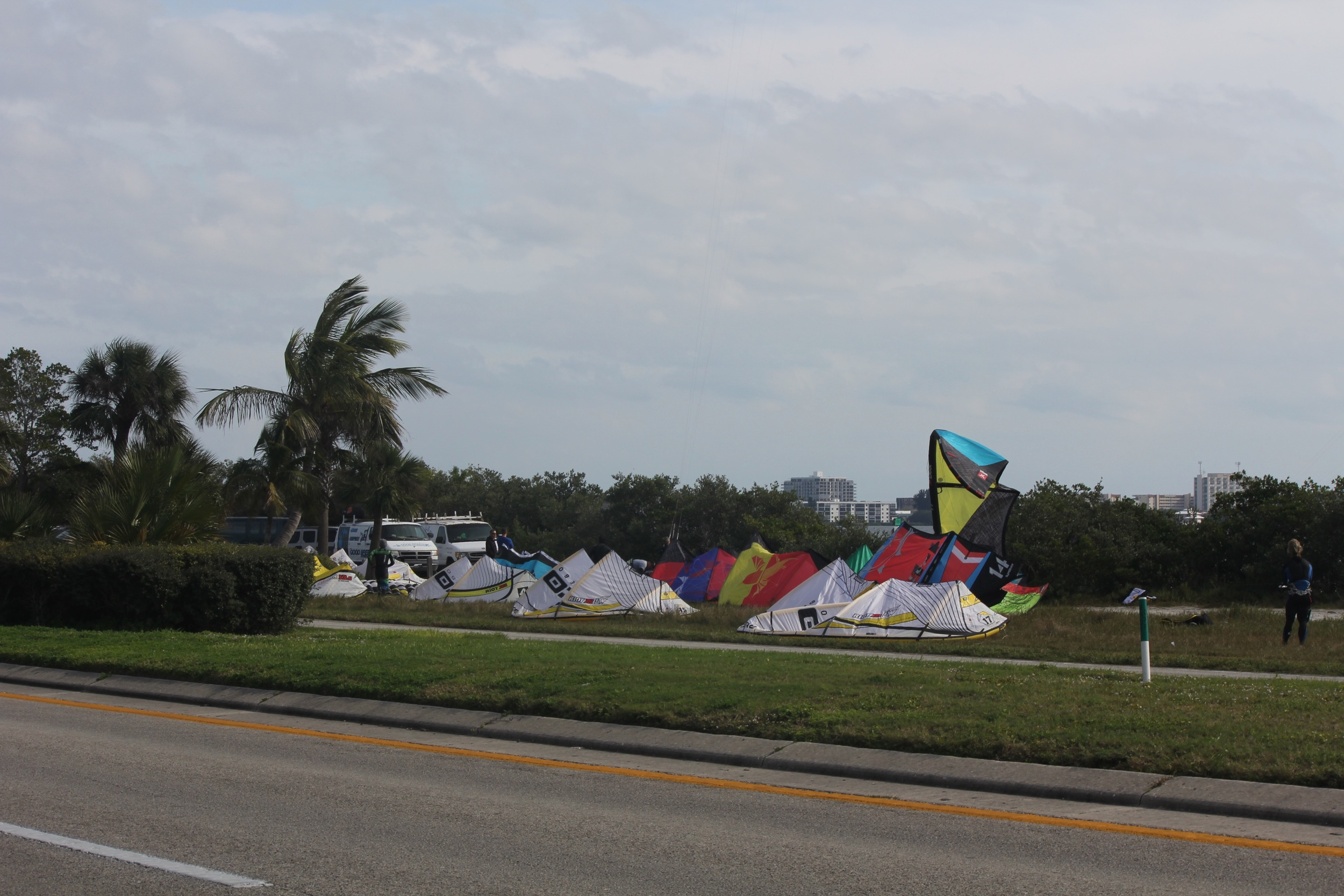 The kiters are right across the street from the windsurfers. The kites on the leeward side of the causeway.
