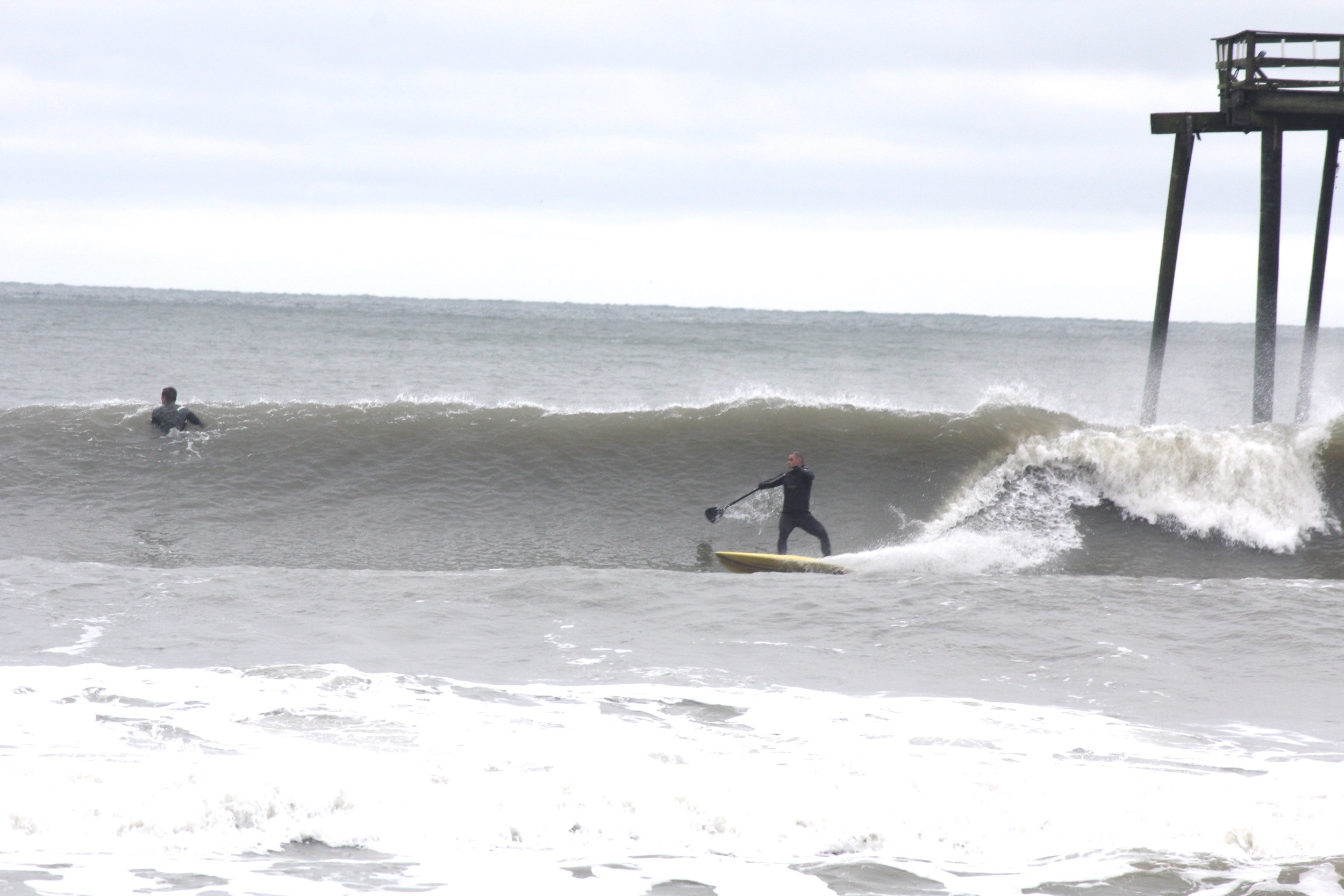 Surf Machine on Jacky's 7'7 Accelerator Pro.  One wave from pier to pilings, to parking spots.