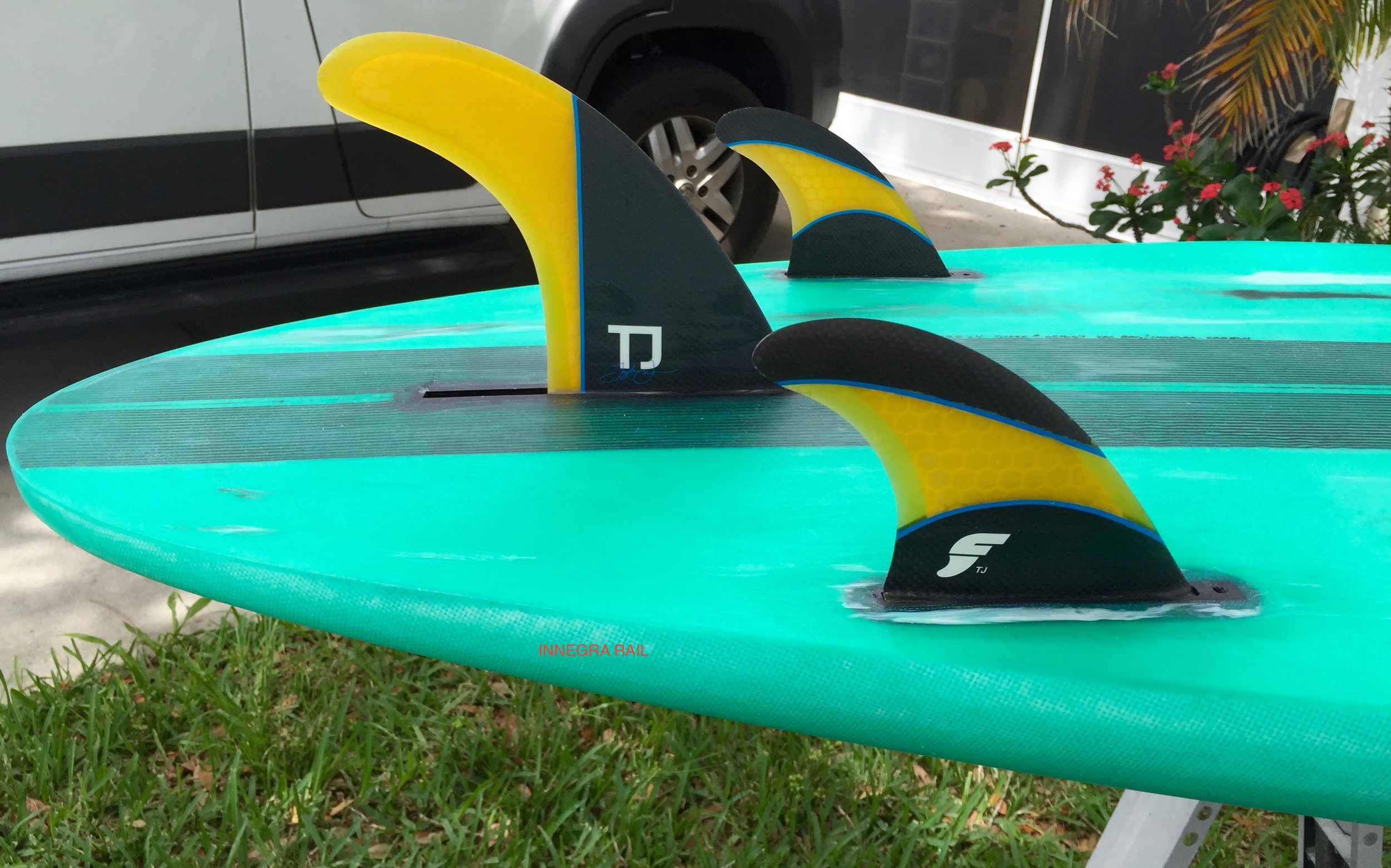 My longboards come setup with the Taylor Jensen set of premium Futures fins.