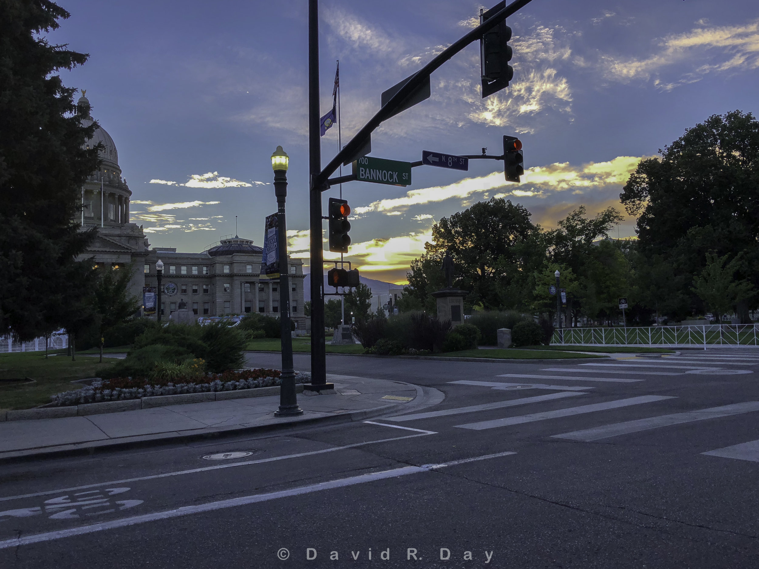 So much good here. You can see what I was going for can't you. Great sky and one of my favorite sunbjects, the Idaho State Capital.  Why doesn't it work, to much clutter. To many poles, to many trees, not quite enought light.  Now? I would like walk arcross the street and get something better.