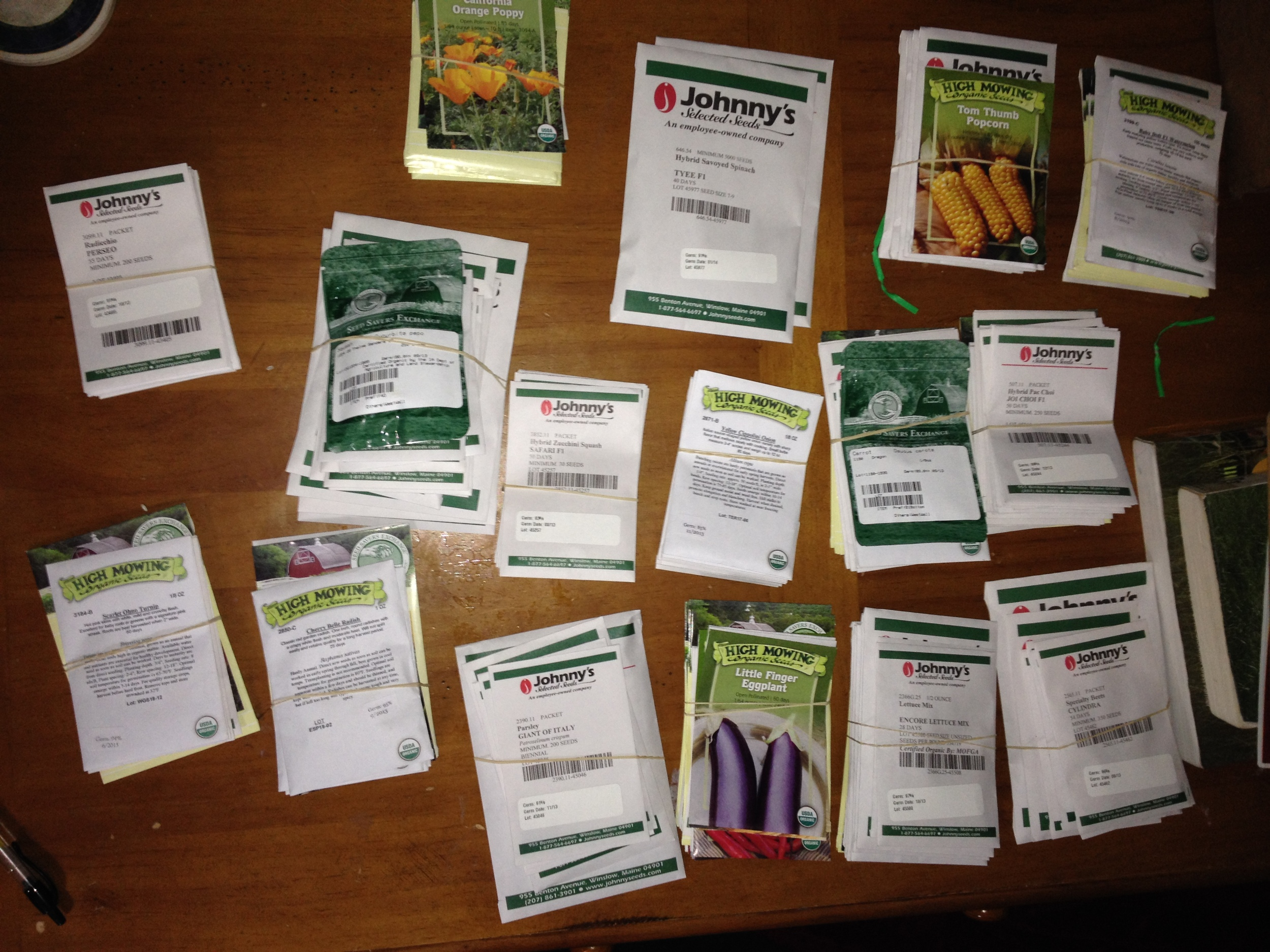 Organizing seed packets to make greenhouse plantings easier.