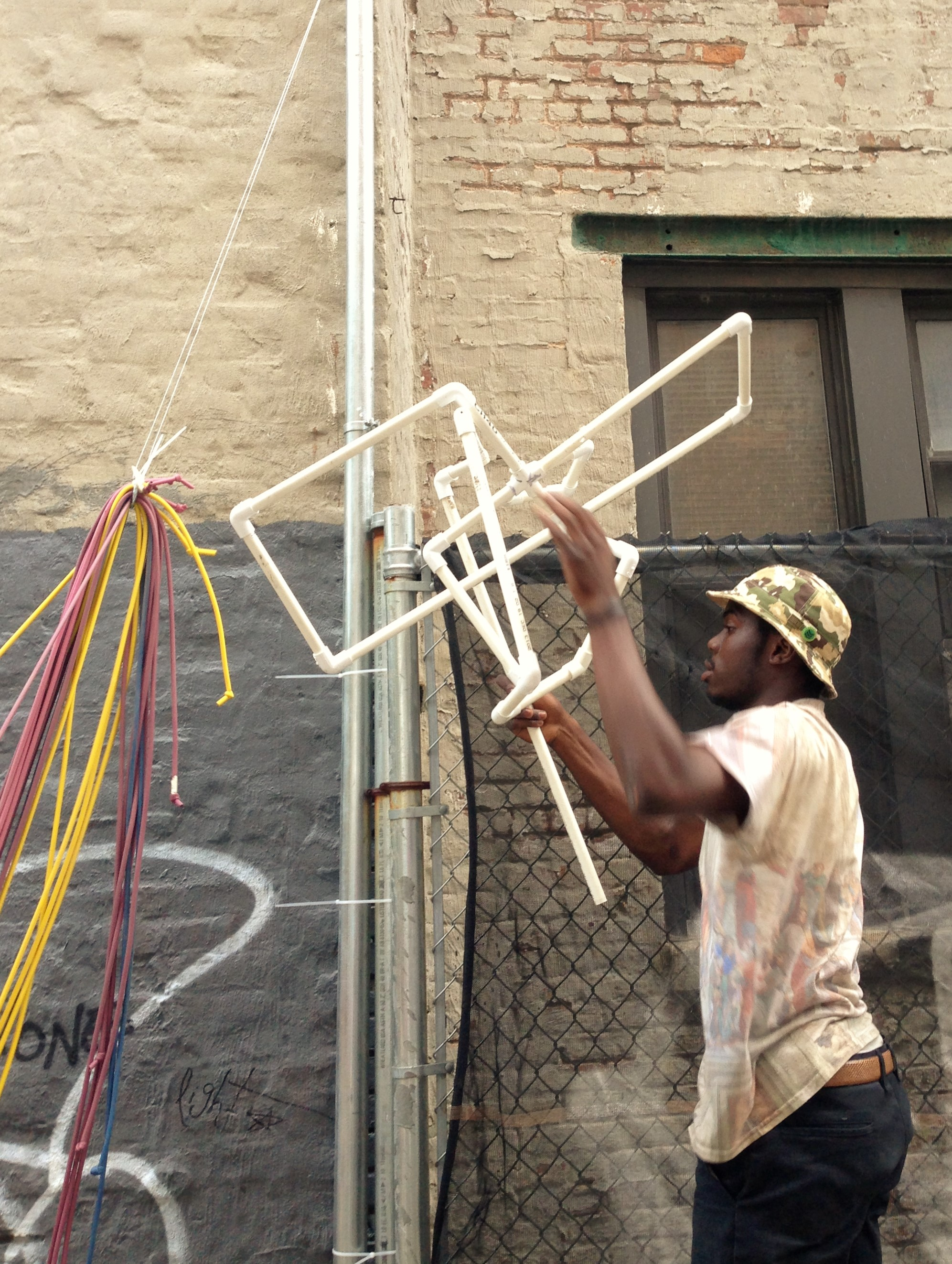 Michael Murillo installing sculpture produced during workshop