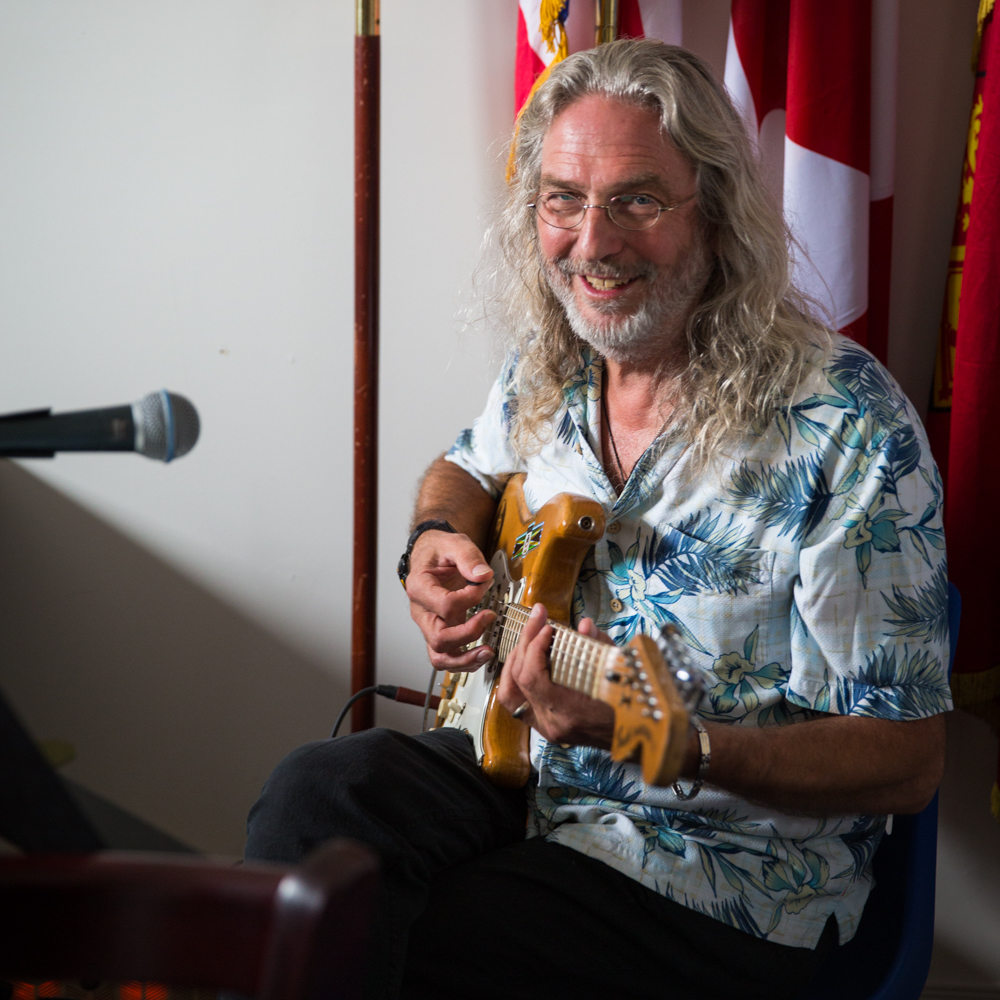 "Sandy Morris - Writers at Woody Point's ""Musician-in-Residence"", Sandy Morris, has been a leading player in the province's music scene for over 40 years. His music is heard weekly on the popular CBC Television series Land and Sea. His latest project, Superpickers, a collaboration with Glen Collins and the late Peter Narvaez, showcases his blues guitar skills on the 2011 CD Blues on the Ceiling."
