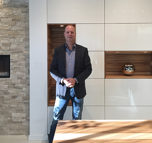 Manfred van Ginkel pictured in front of Warendorf's Matt Sweet Gum veneer with White High Gloss lacquer.