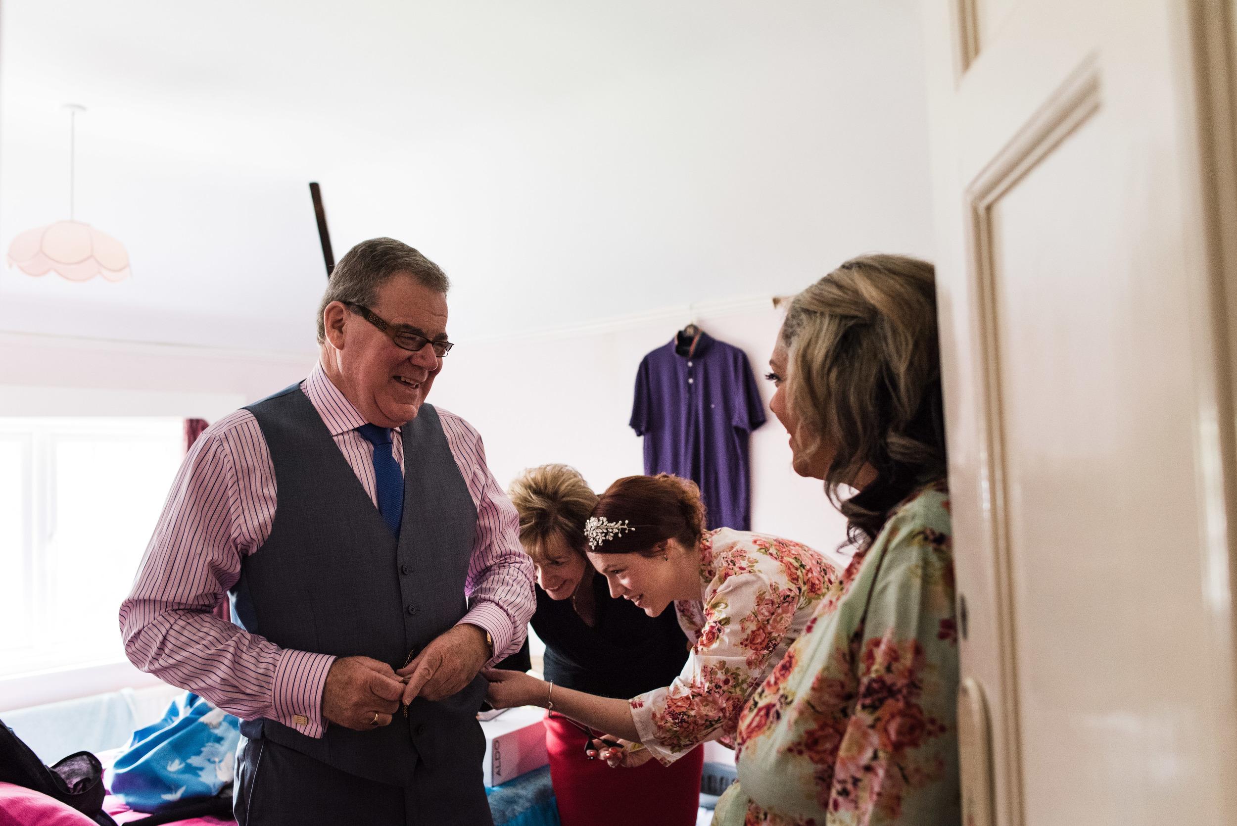 father gets finishing touches - ufton court wedding photographer