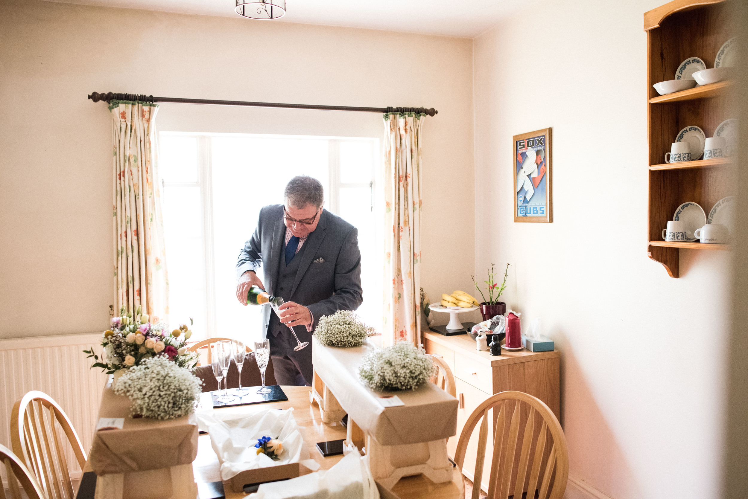 father pouring champagne - ufton court wedding photographer
