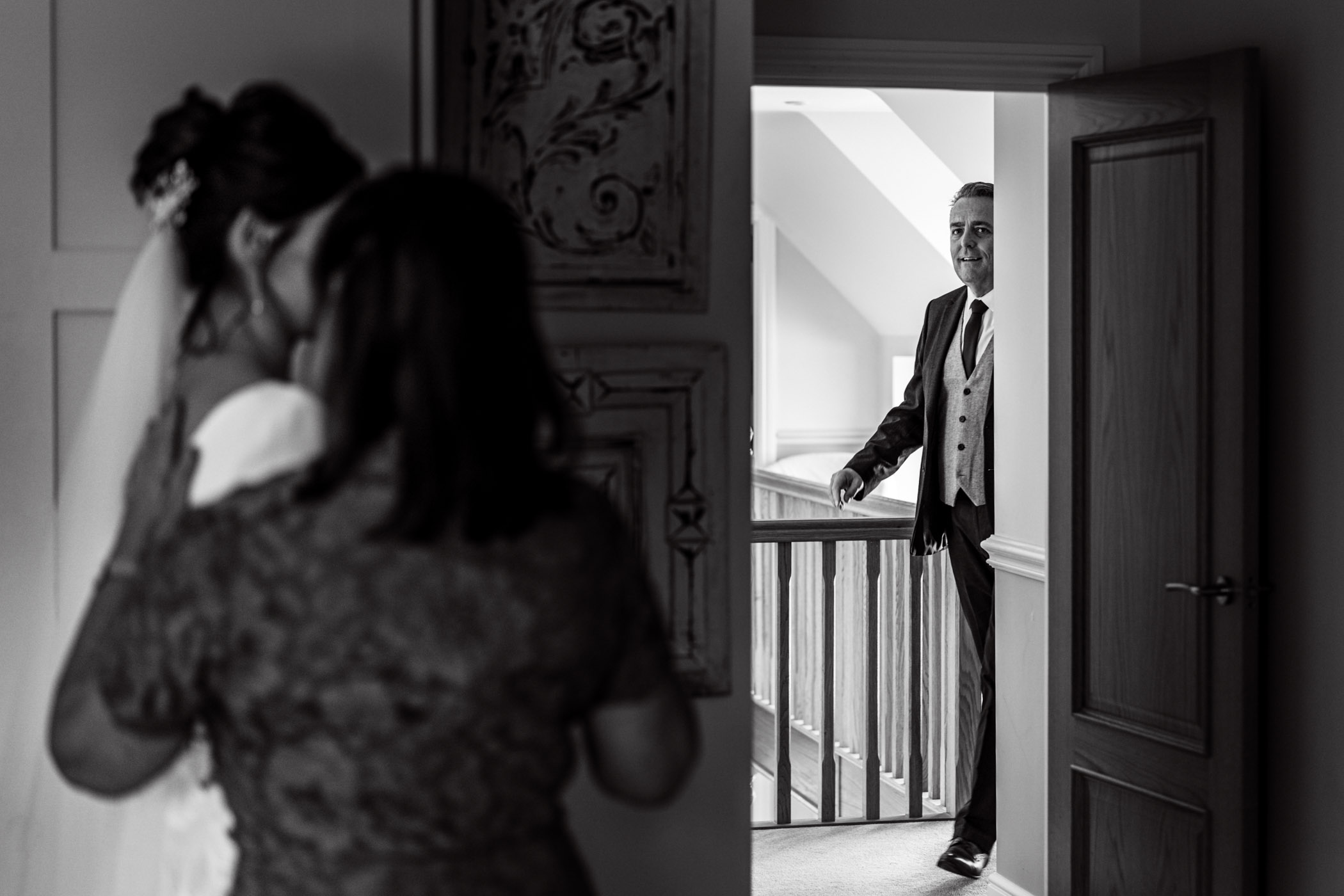 I'm starting with probably my favourite frame from their day. Early on Becky had just finished preparations and her father is ready to see her for the first time in her dress. I really like how her mother is lending a comforting hand. Love the sense of anticipation… The next frame is seconds after