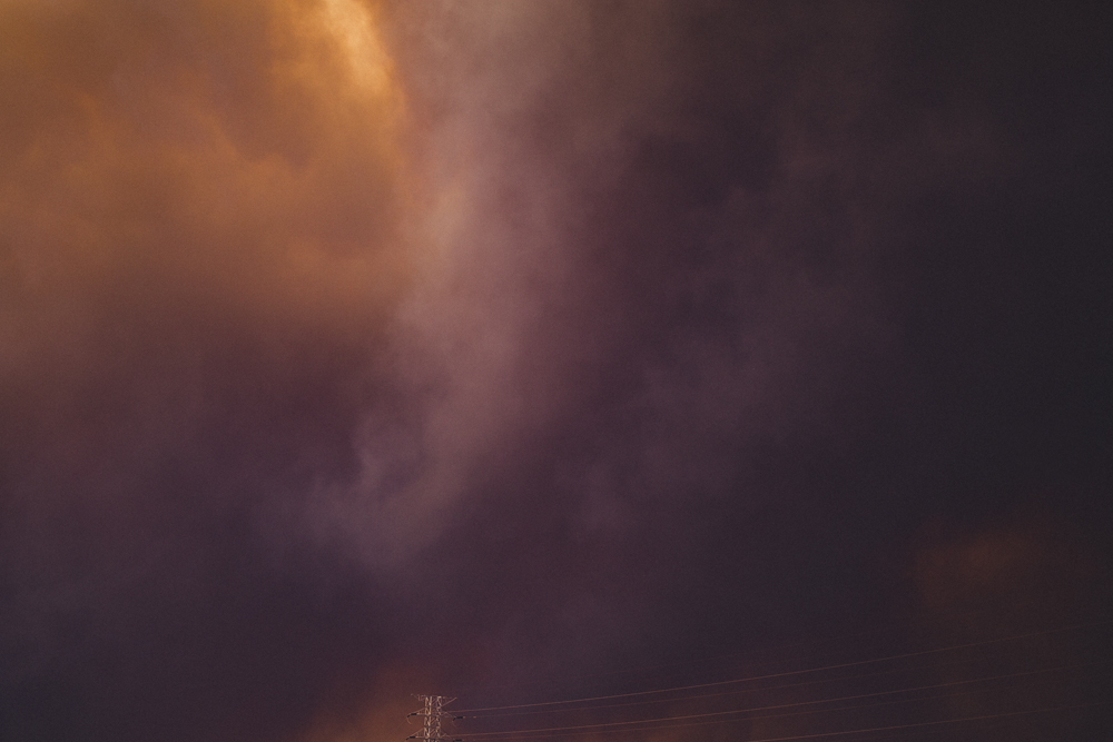 the sky smothered in smoke from the terrible bushfires nearby.