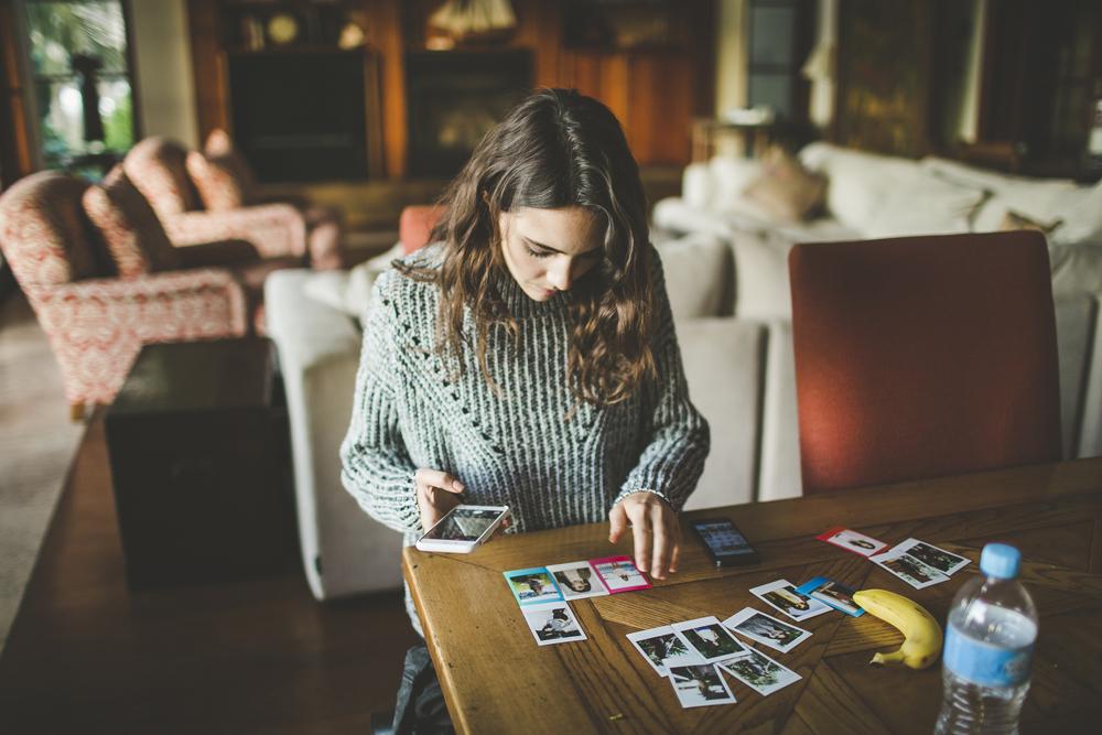 Amelia going through all the polaroids we took that day.