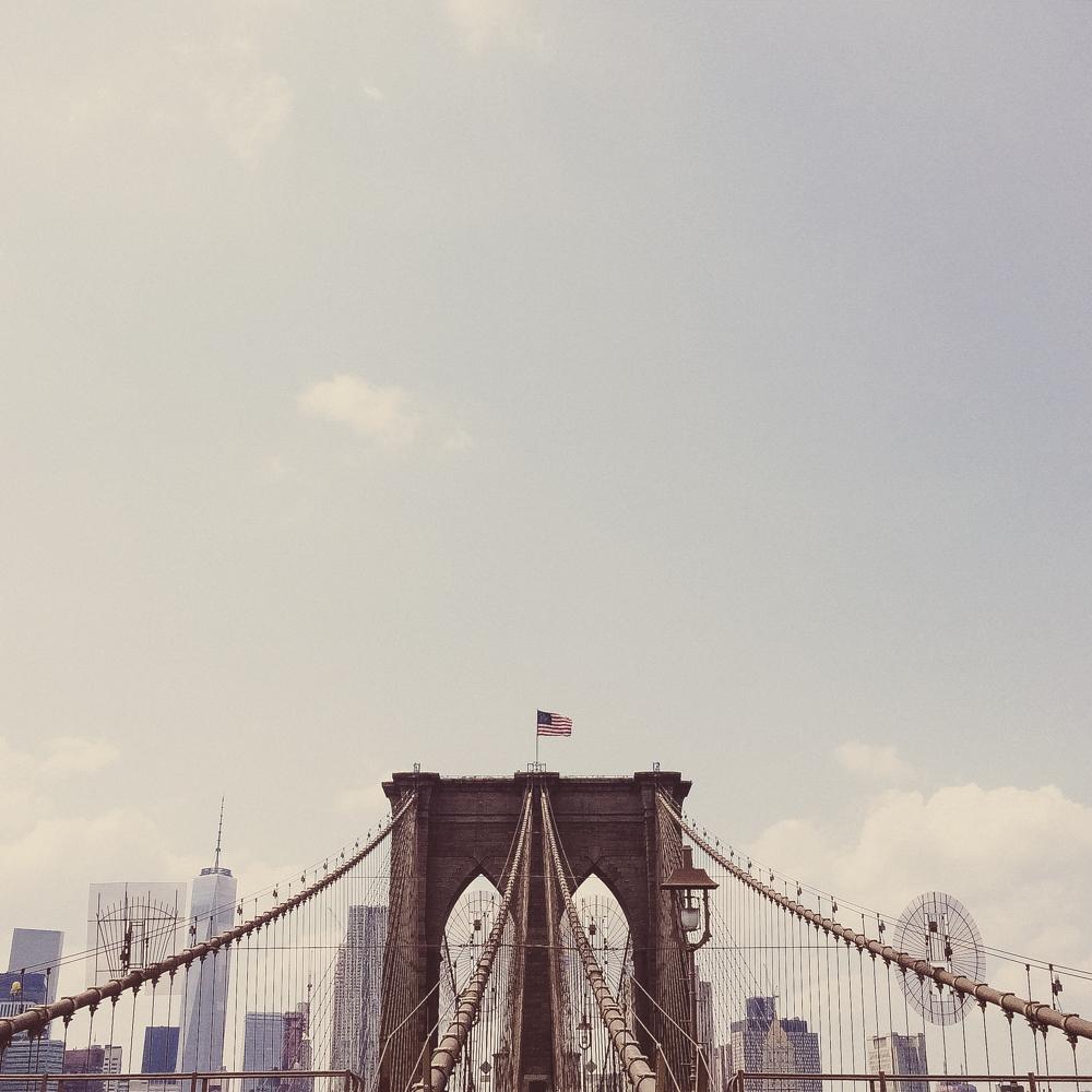 Walking along Brooklyn Bridge.
