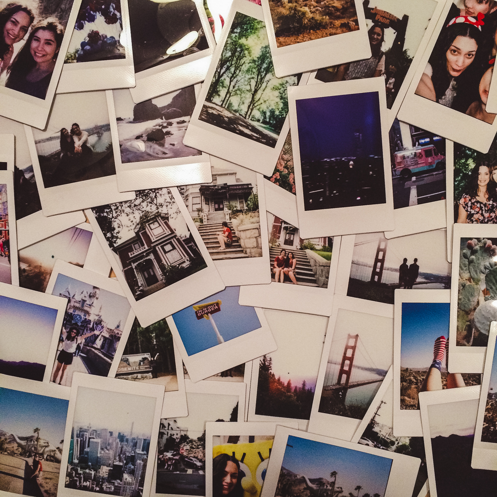 All my polaroids from our trip so far spread across the entire dining room table.