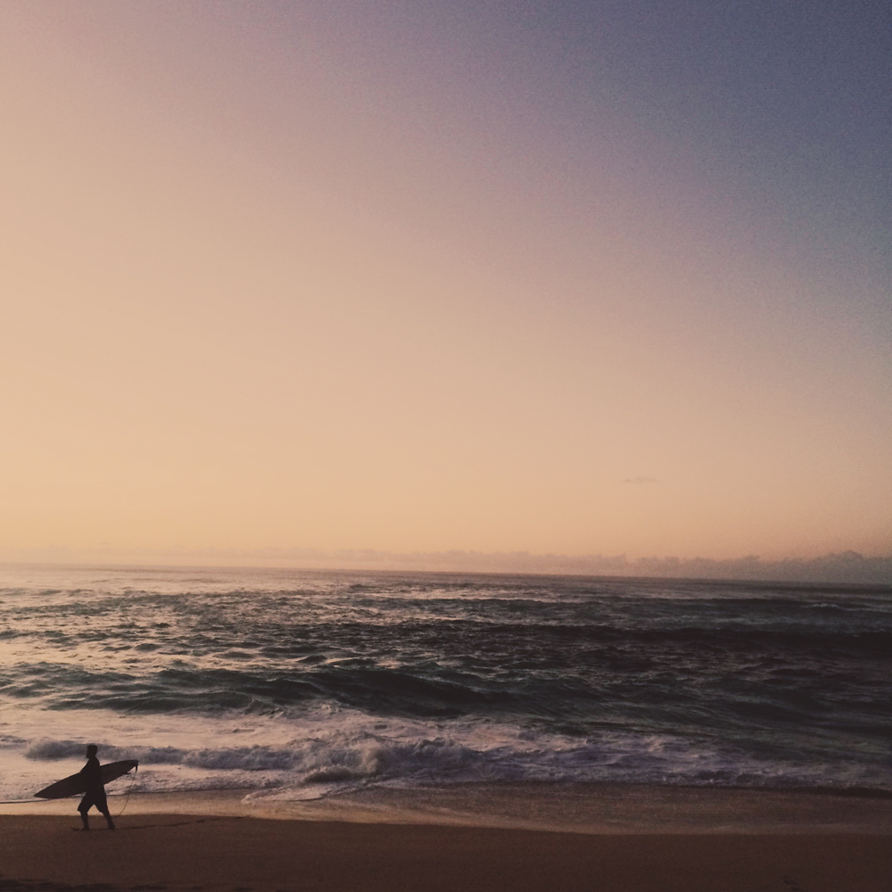 Watching the waves and sun set at the Pipeline.