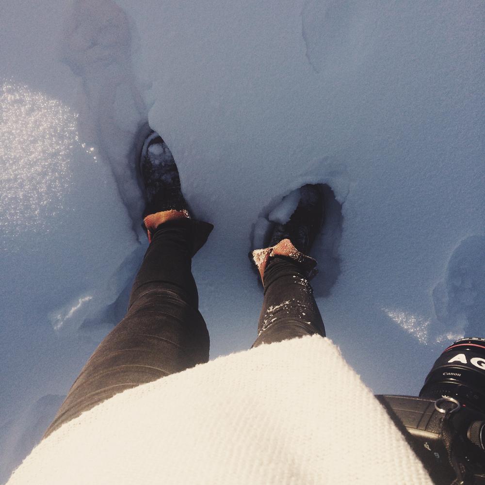 Leaving footprints in the fresh snow.