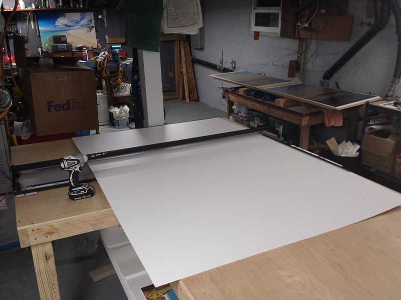 Cutting the Sintra to mount the prints to. (Click to Enlarge)