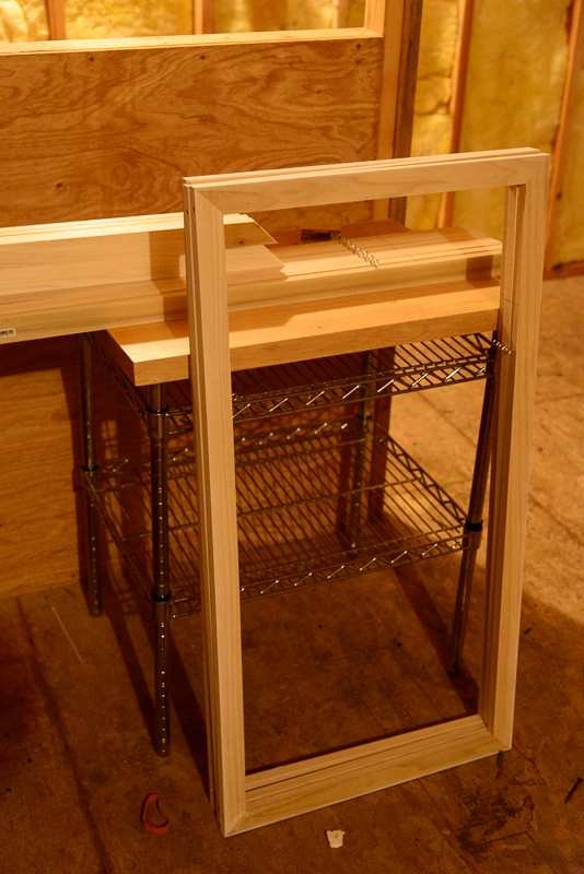 Building wooden frames for rigidifying and hanging the prints. (Click to Enlarge)
