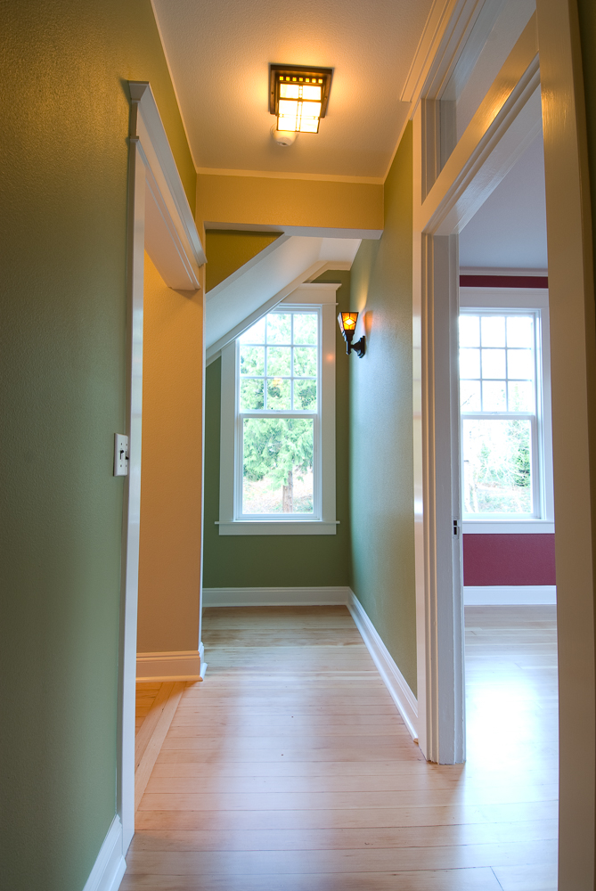 Hallway and top of same stairs after.