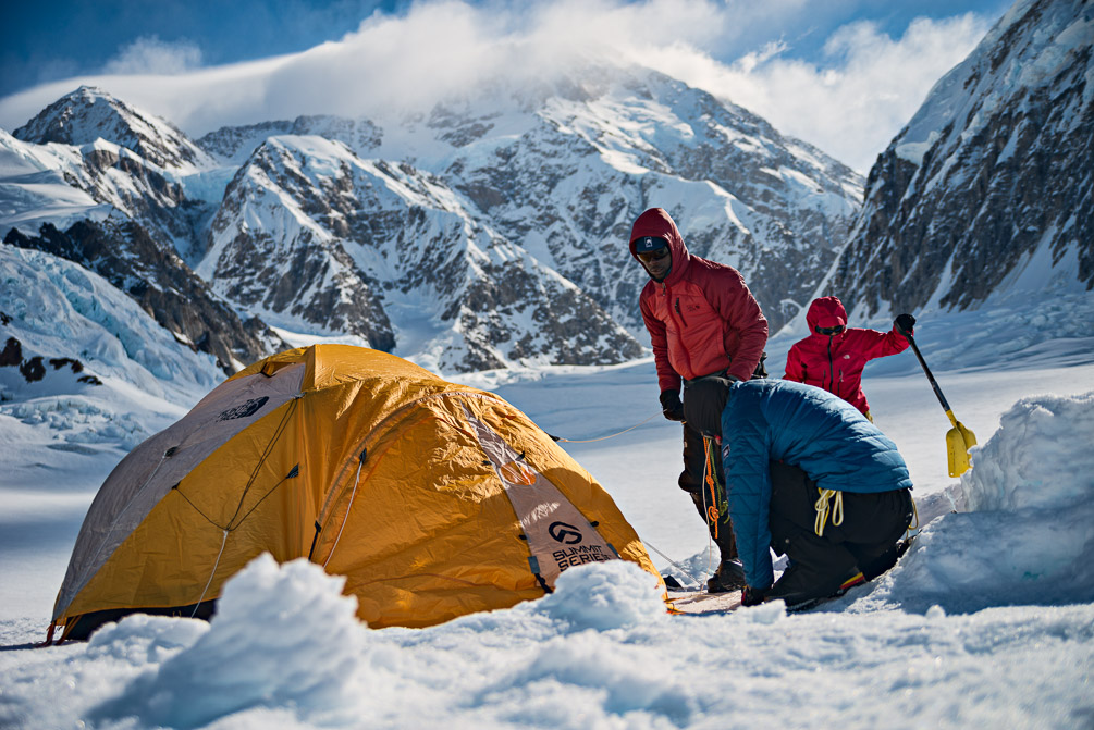 Setting up Camp 1 with Denali as background.