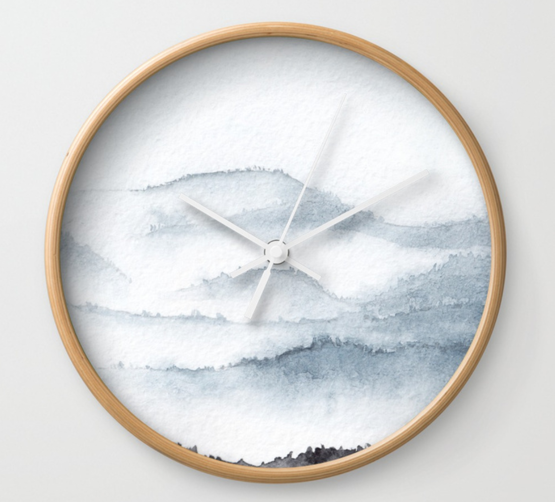 mountains watercolour wall clock by stuffxwonderland for society6 on ashleyfisher.ca