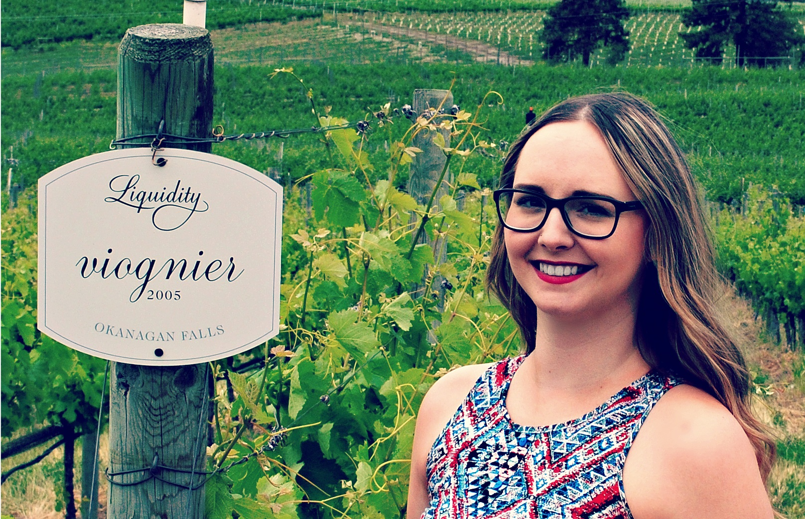 Ashley+Fisher+at+Liquidity+Winery+viognier+grapes