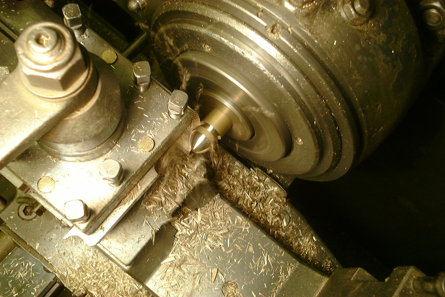 Solid Premier stair rods being turned on a lathe - the initial stage of production.