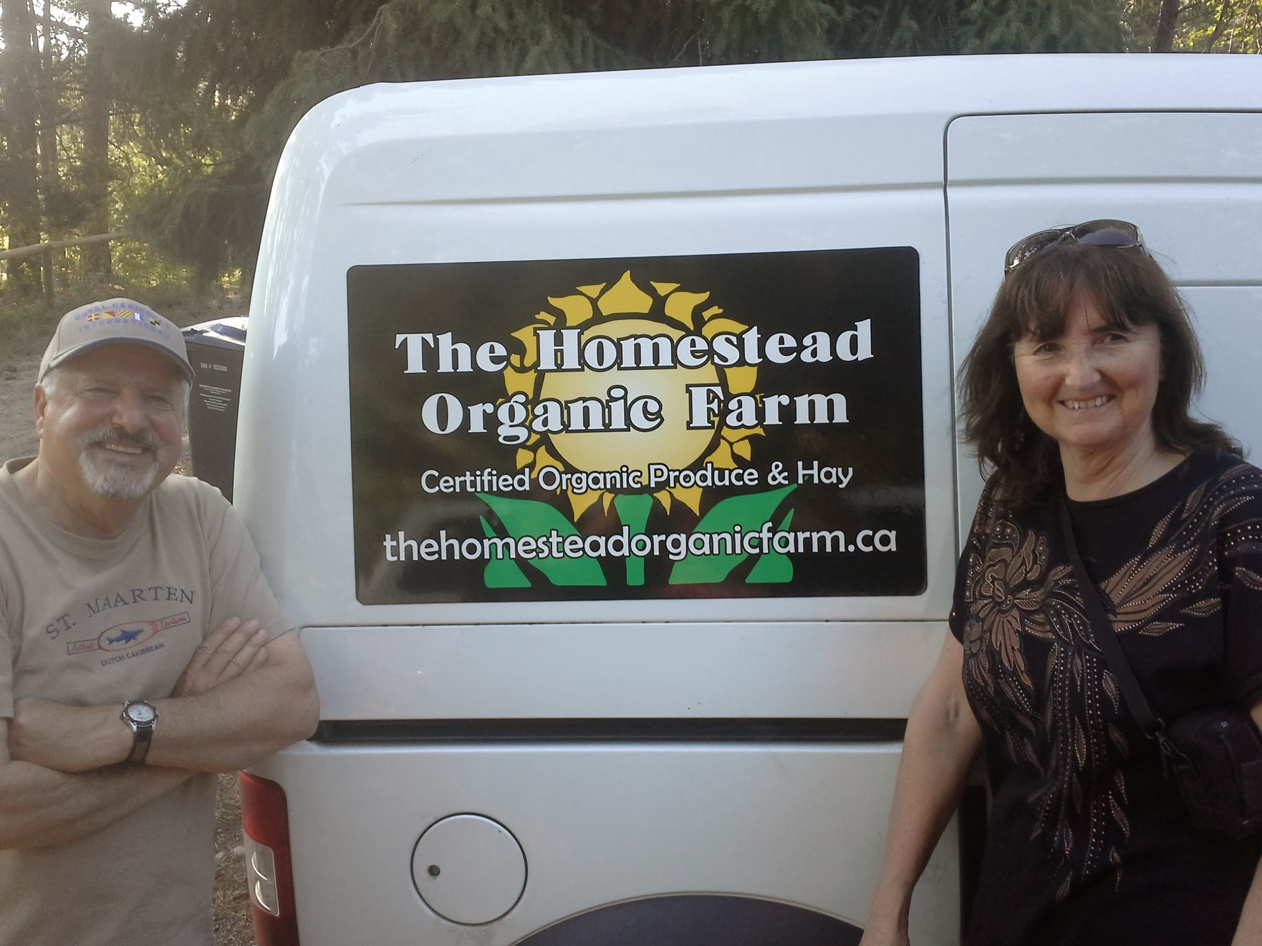 Vanessa's parents pose beside their birthday gift for Jordan: new logos for the delivery van!