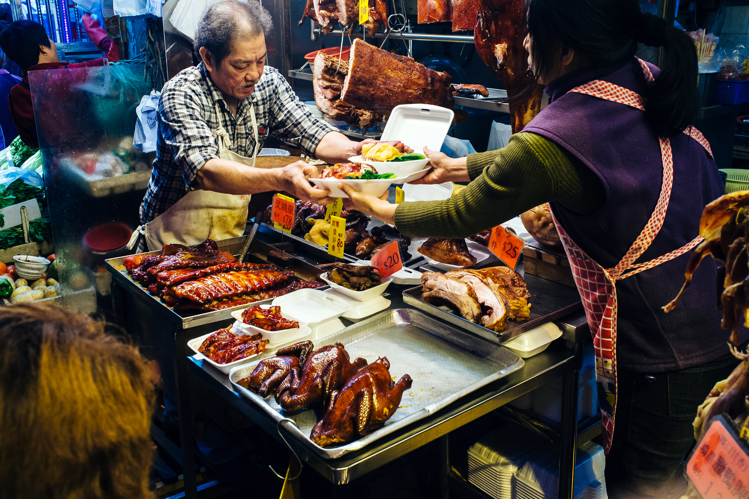 Every market has a person selling containers of assorted cooked meats.