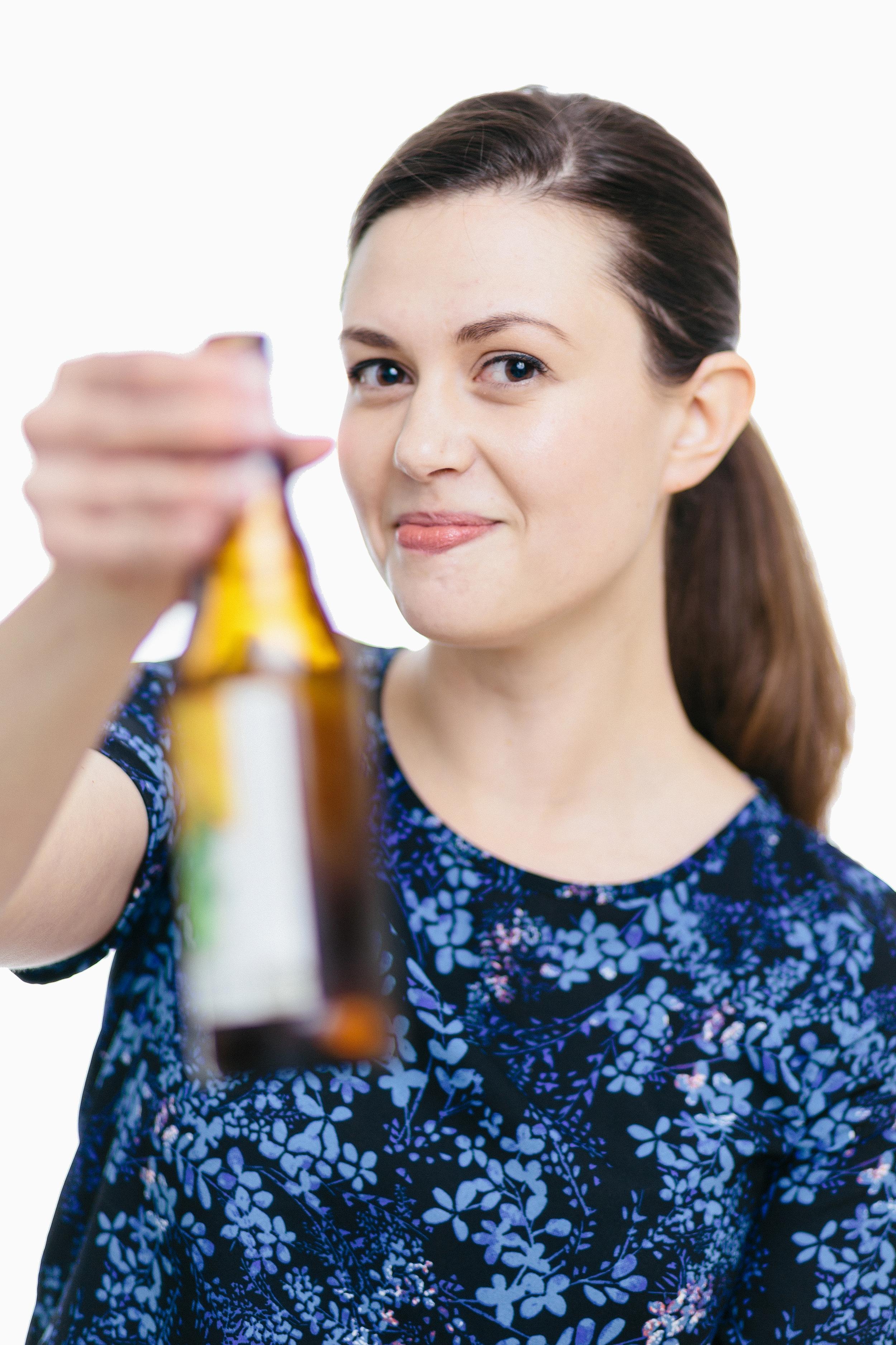 Kim Clean Headshot with beer edit.jpg