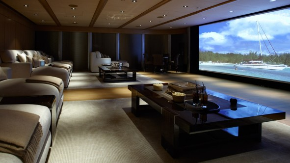 Luxurious-Home-Theater-Design-with-Big-Home-Theater-front-Comfortable-Sofa-Bed-near-Square-Table-on-Nice-Carpet-under-Lighting-on-Simple-Ceiling-591x332.jpg