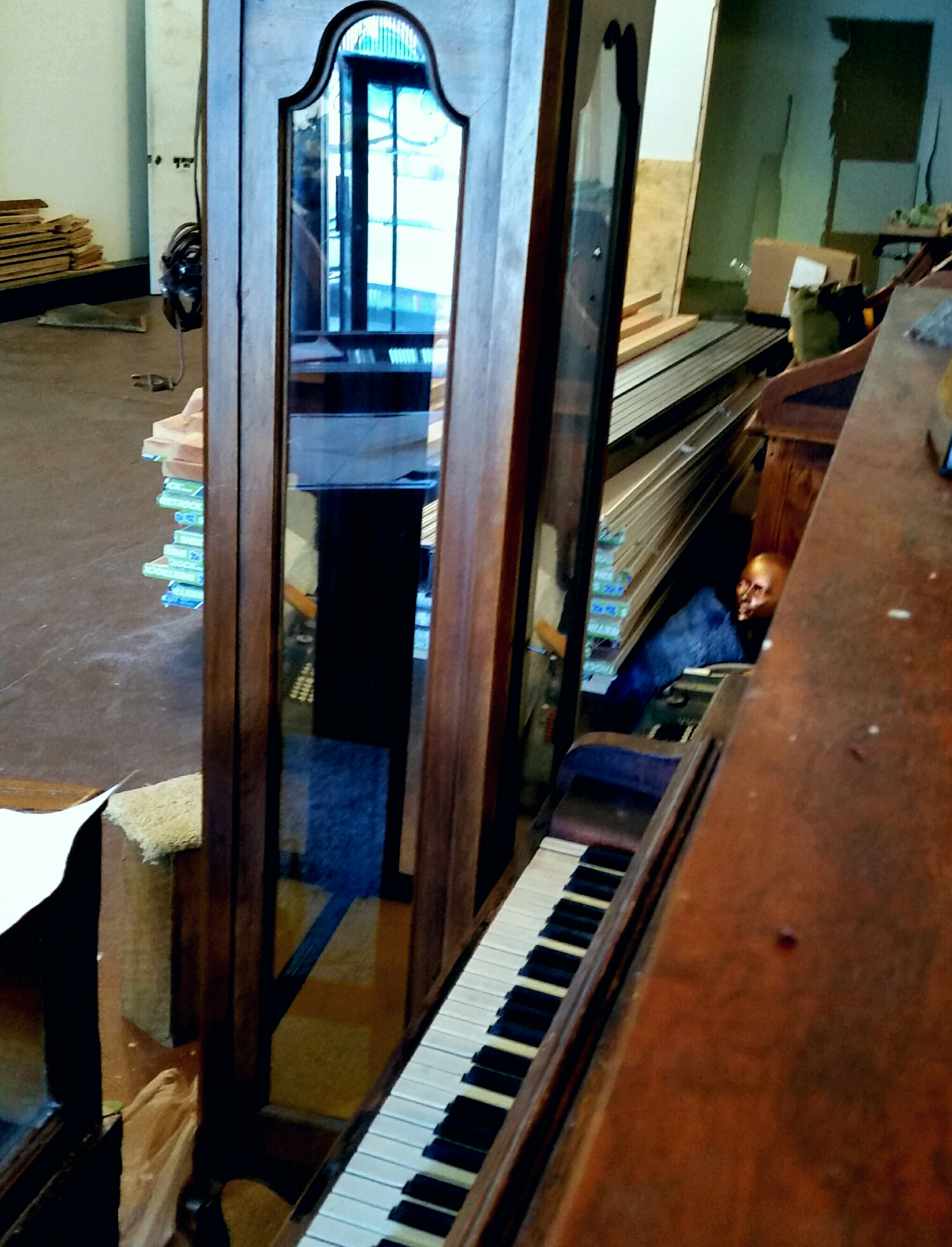 A piano , some display cabinets , what's missing here ?