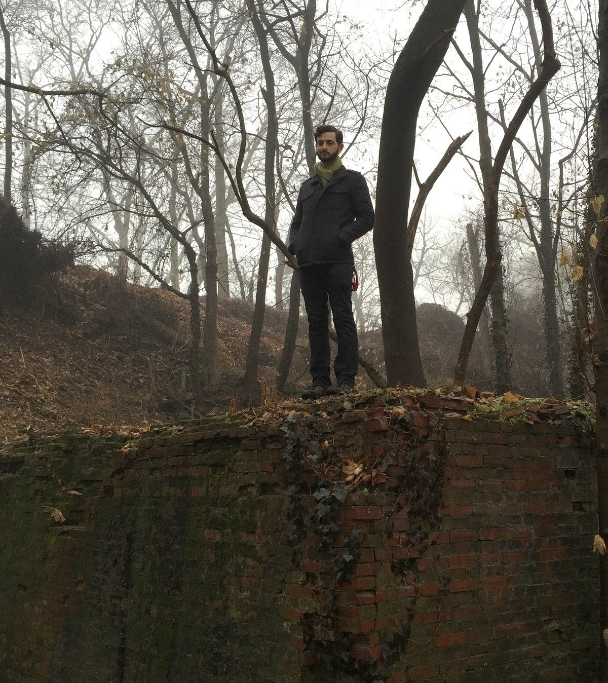 Standing below, behind the broken wall up on the hill behind me.Photo Credit: Tom Newfordge