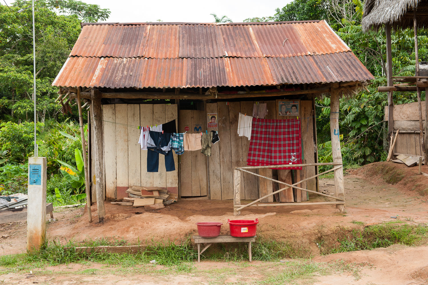 A typical home in the Amazonian village of Puerto Prado, Peru. More than 60% of the country's territory is covered by the Amazon rainforest, home to over 300,000 indigenous people who depend on it for their livelihoods. Although Peruvian law recognizes the rights of indigenous people to their land, it still foresees the possibility of granting concessions over these lands, if doing so is deemed in the national interest.