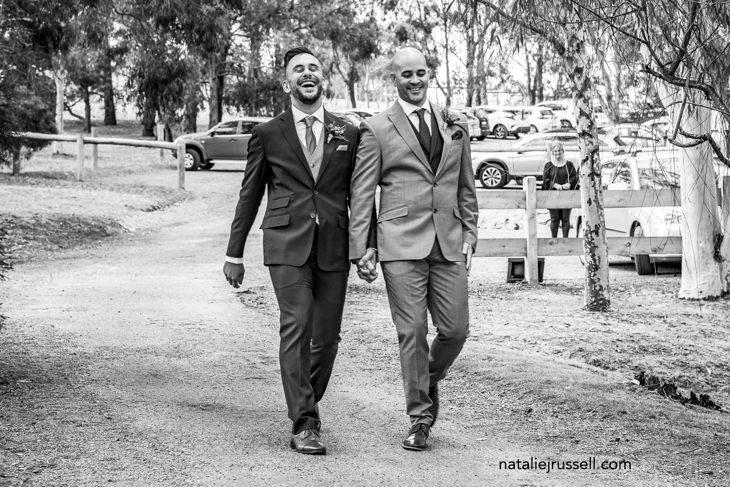 Chris & Steven   Chris (left) and Steven (right) positively strut down the aisle. Photo – Natalie J Russell