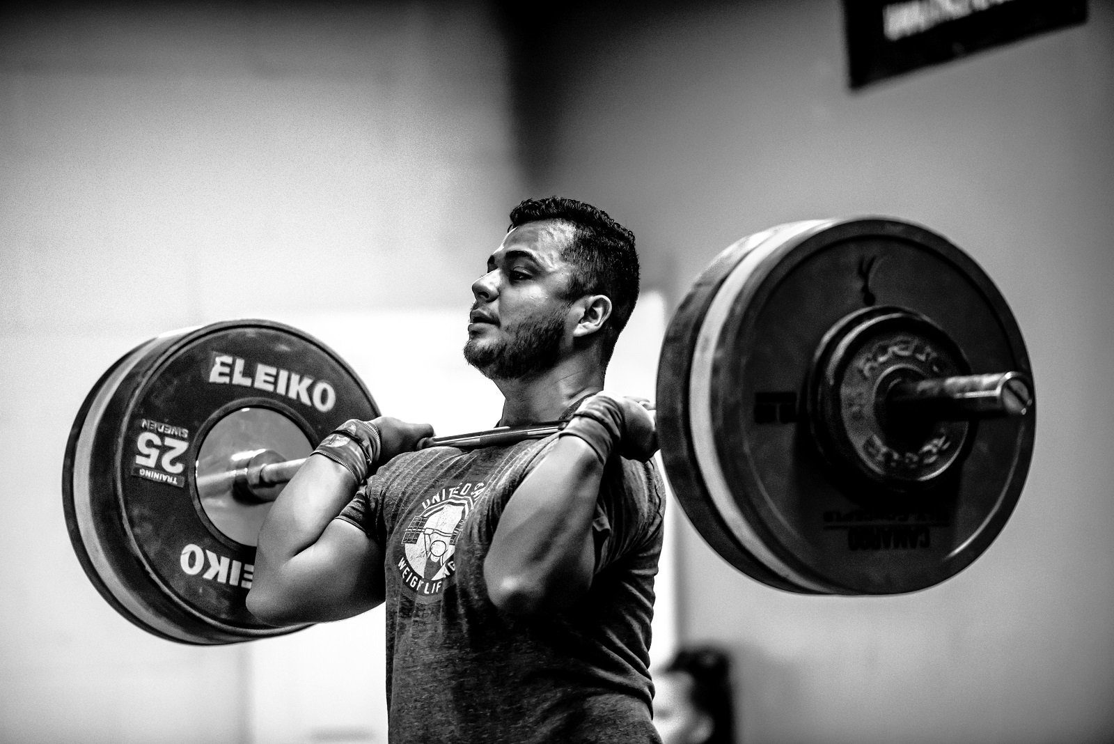 Clean - The clean and jerk is a composite of two weightlifting movements, most often performed with a barbell: the clean and the jerk. During the clean, the lifter moves the barbell from the floor to a racked position across the deltoids, without resting fully on the clavicles.