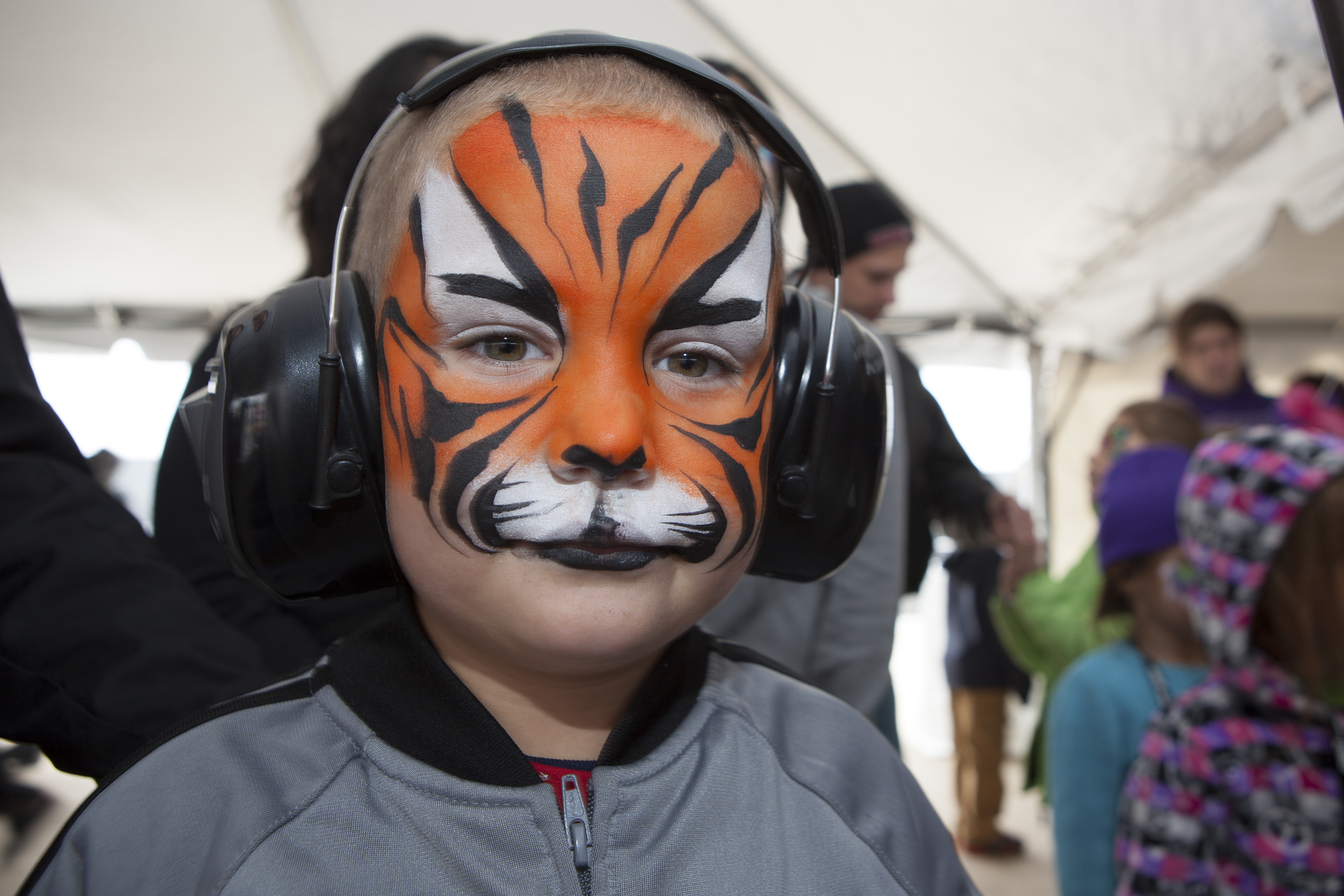 Face painted spectator at the Alliance Air Show, Fort Worth, TX, USA Copyright © Kipp Baker, All rights reserved.