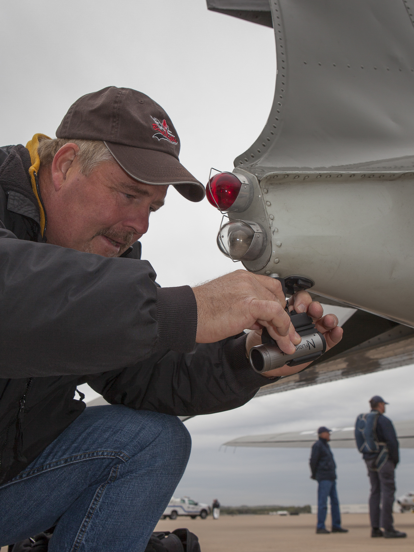 Alliance Air Show field tech attaches video camera for parachute team. Copyright © Kipp Baker, All rights reserved.