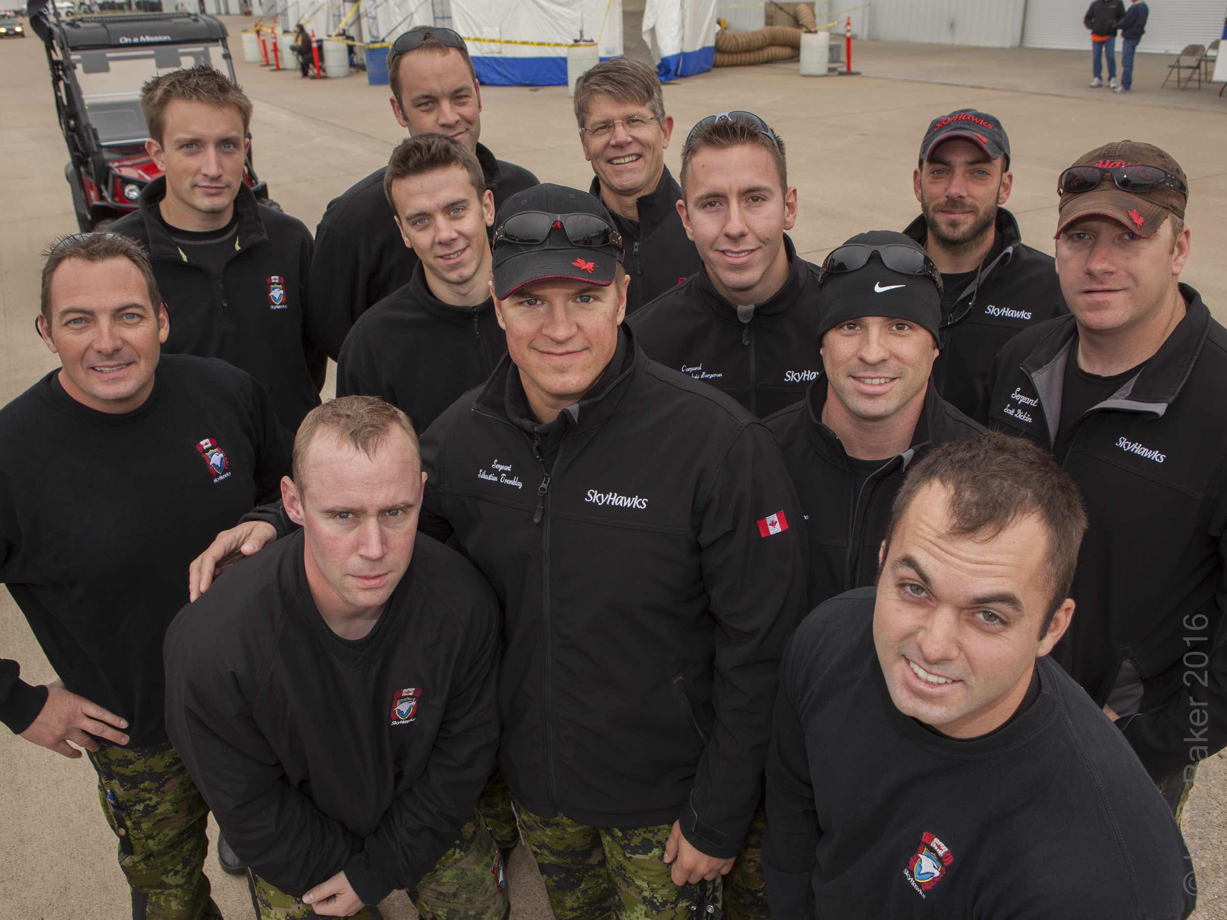 Shot for Bell Helicopter internal marketing campaign showing CEO John Garrison (back row with glasses) posing with parachuting jump team - Alliance Air Show. Copyright © Kipp Baker, All rights reserved.
