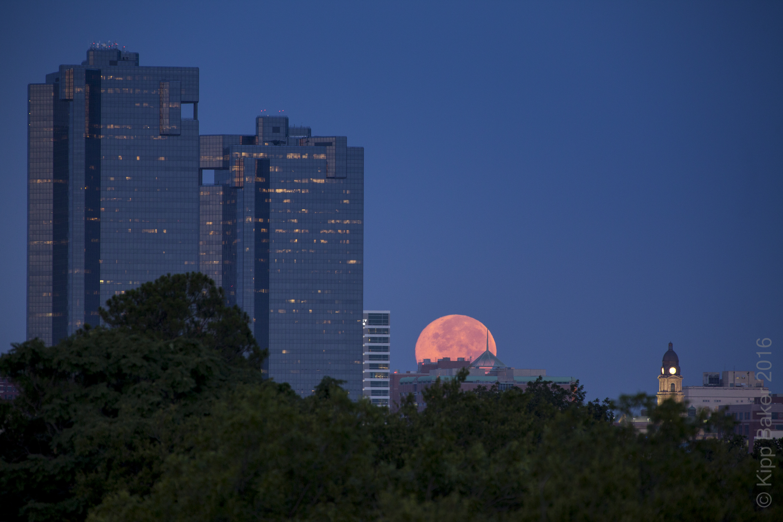 Supermoon setting over Fort Worth skyline at dawn Copyright © Kipp Baker, All rights reserved.