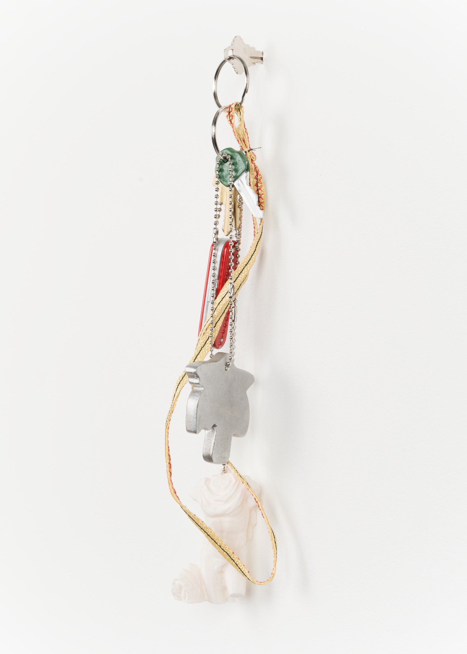 Chris Bradley  Token (Palm #2)  2013 Cast aluminum, wood, PLA, kevlar, key rings, chain 15h x 4w x 3d in CB055