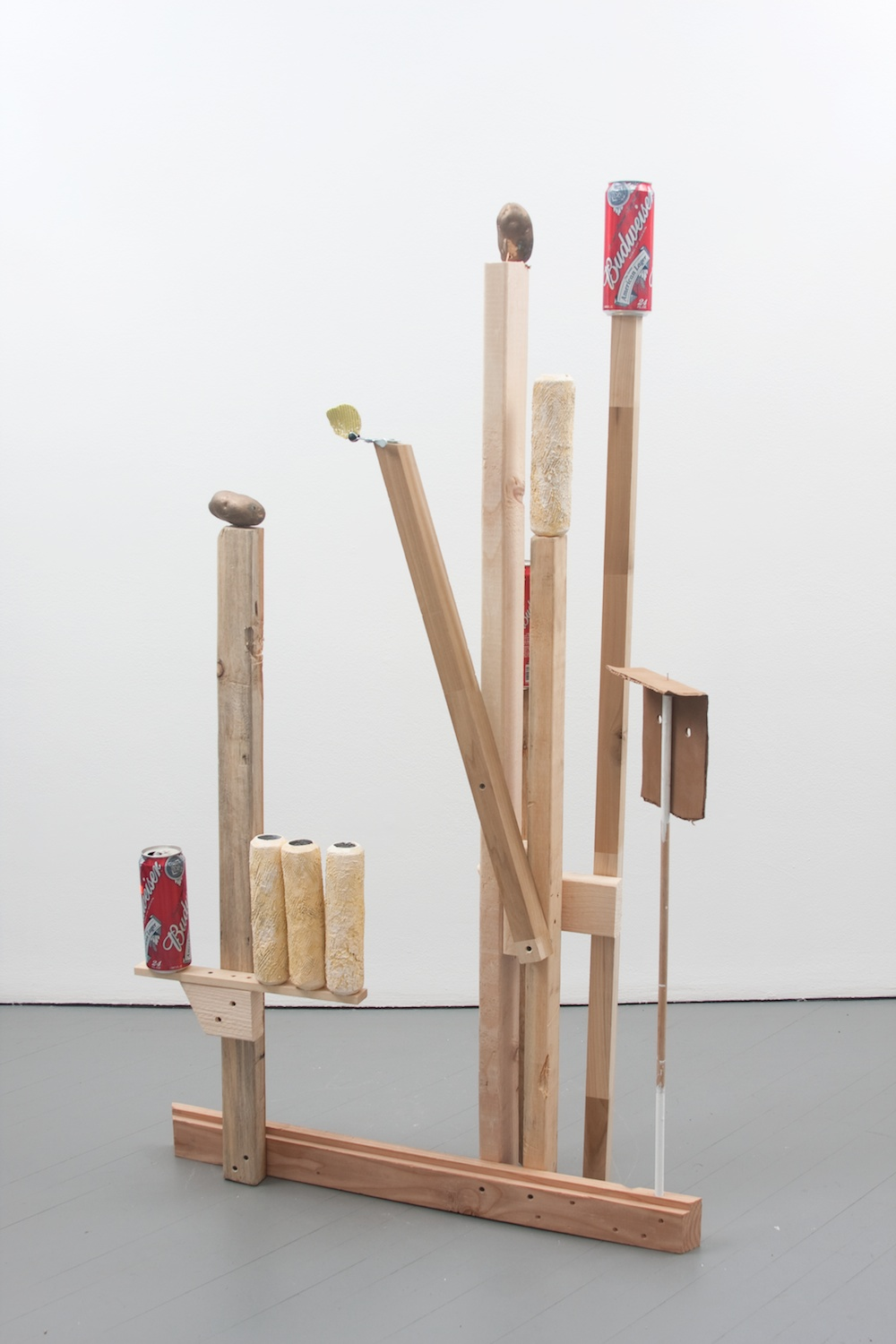 Chris Bradley  Target #1  2011 Aluminum, cast aluminum, cast bronze, paint, wood, beer cans, clamp 62 ½h x 35w x 13d in CB001