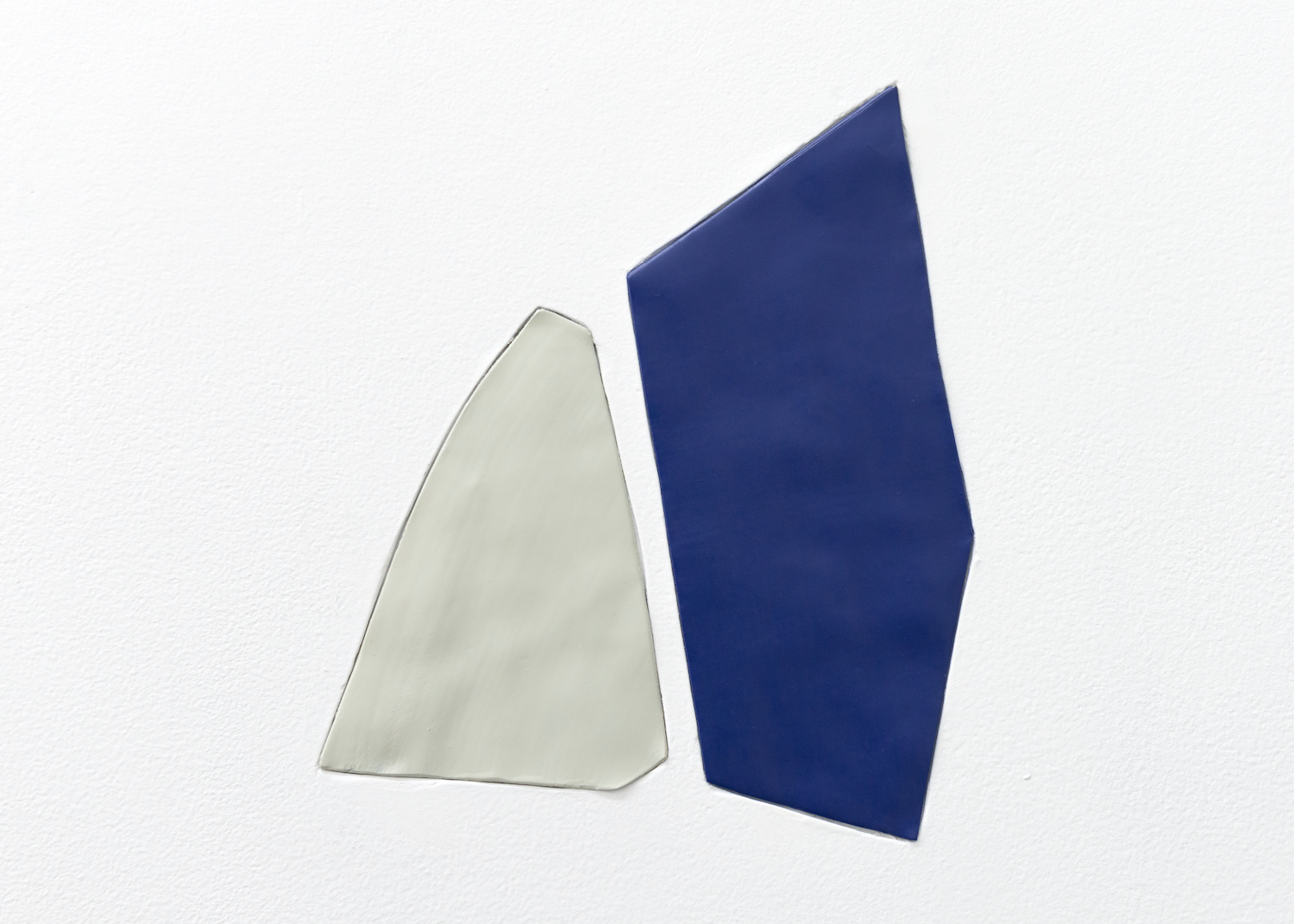 Nancy Brooks Brody  Merce and Scotty  2014 Oil enamel on lead embeded into wall 9 ½h x 8w in NBB002