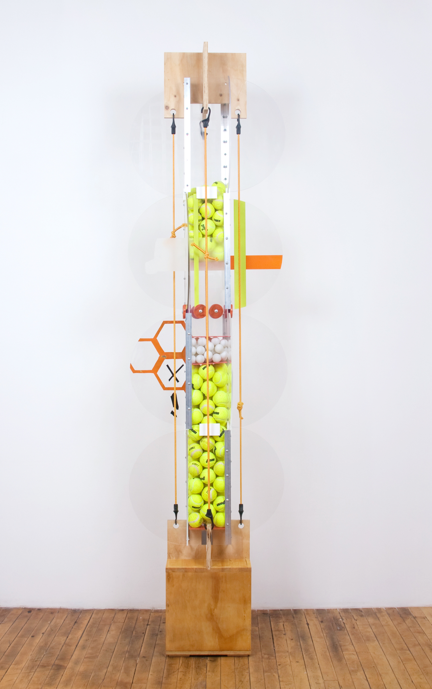 Jason Meadows  Vehicular Cellular Pattern  2008 Wood, extruded aluminum, hardware, plexi glass, spray paint, tennis balls, and mixed media 78h x 26w x 26d in JM018