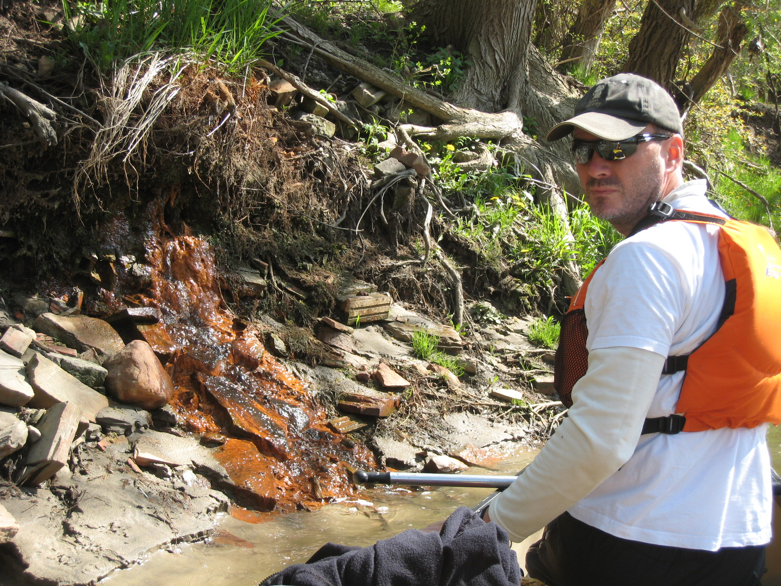 Mark Mattson investigates discharge into the Don River during the annual Paddle the Don event. (Photo credit: Julia Hambleton)