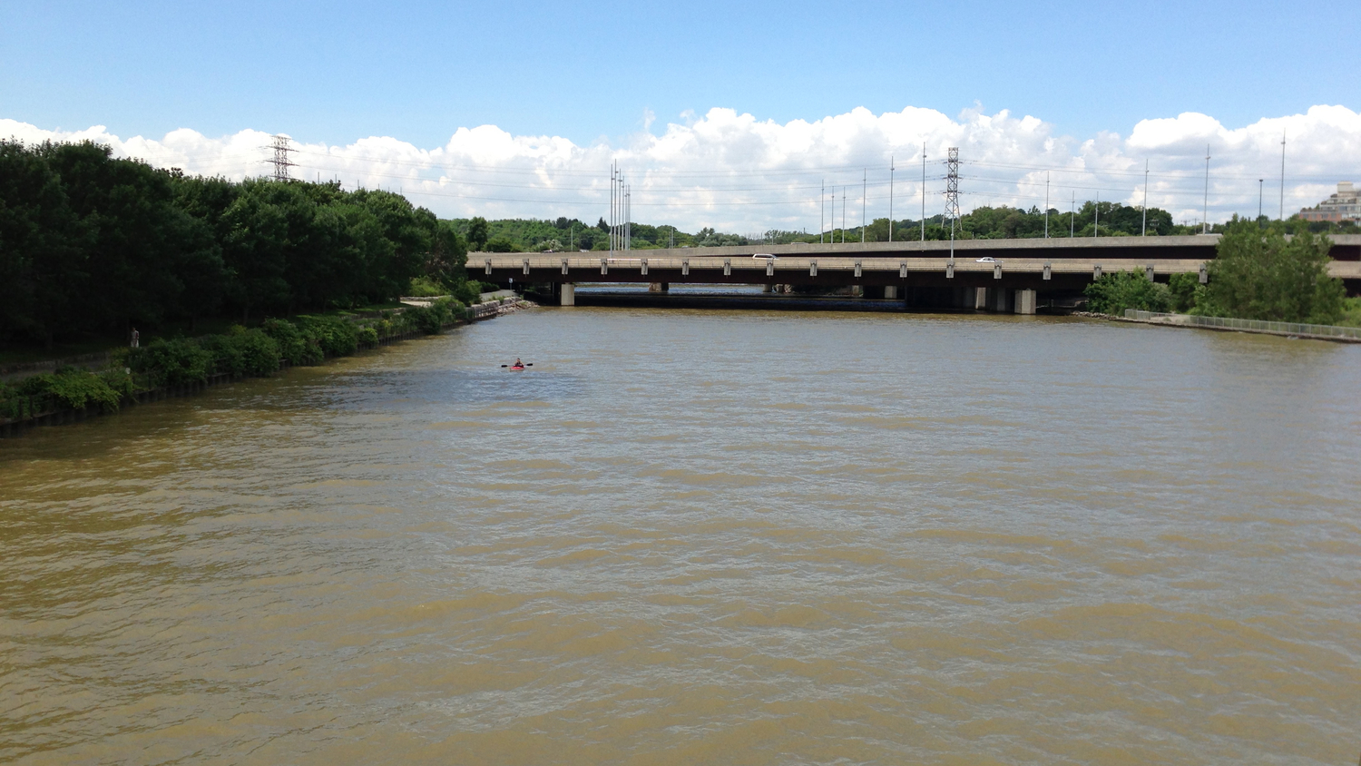 A kayaker paddles through sewage pollution on the Humber River, July 12, 2013. Photo by Lake Ontario Waterkeeper.