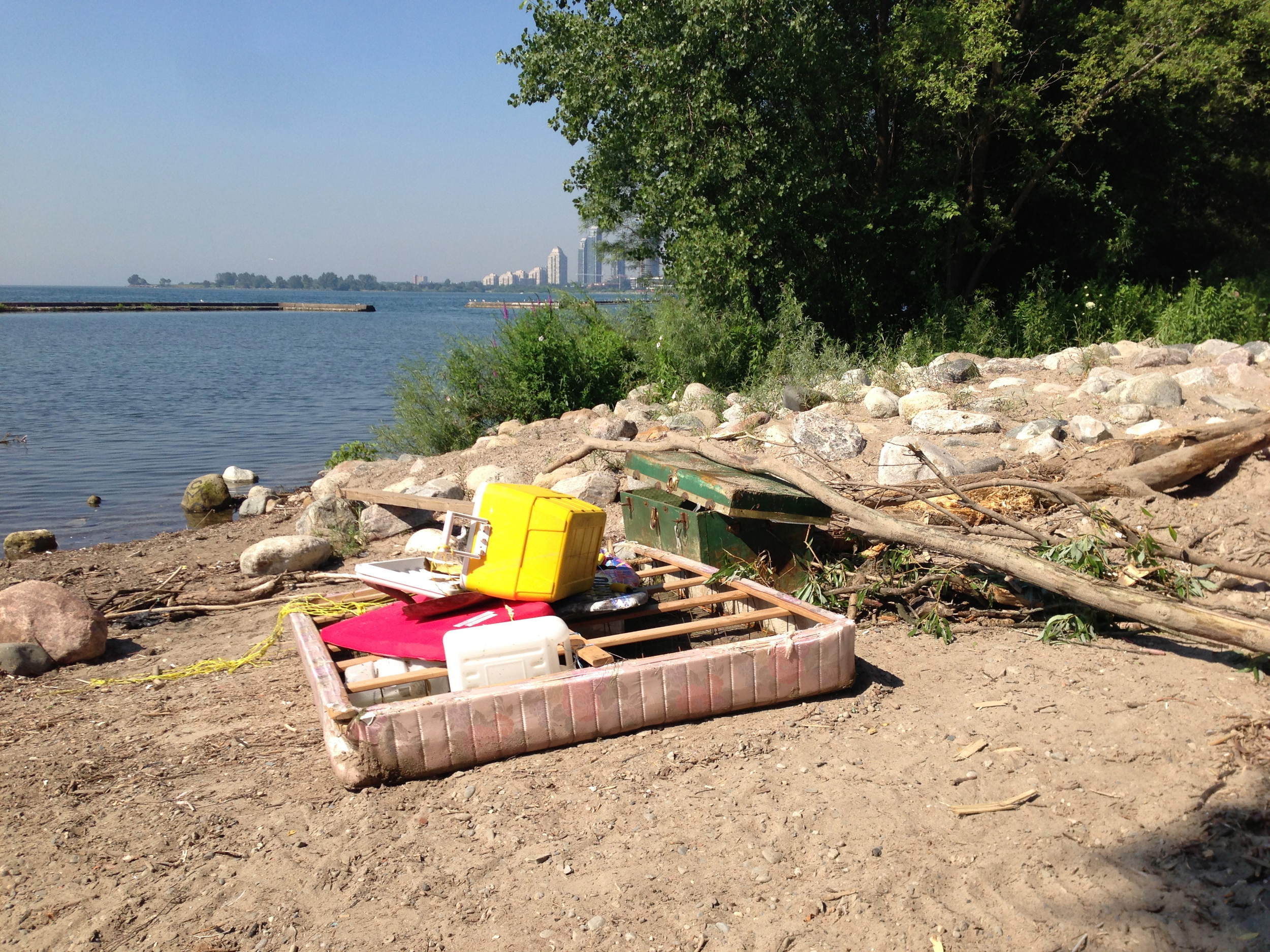 Materials and debris washed ashore following the major flood in Toronto (2013). Photo courtesy of Lake Ontario Waterkeeper. July 16, 2013.