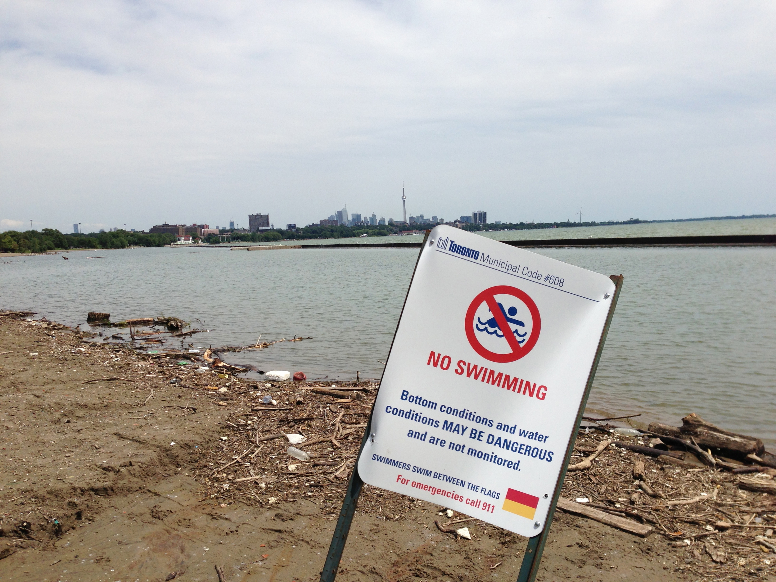 Permanent no swimming sign at the mouth of the Humber River. There are no advisories for people using this area for other recreational activities like paddling. Photo courtesy of Lake Ontario Waterkeeper. July 12, 2013.