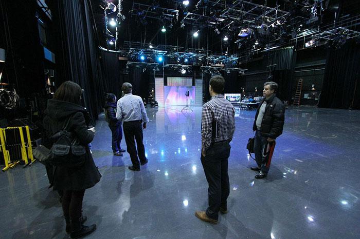 Production team discussingpotential plans during asite visit at the CBC. (Photo:Nicholas de Pencier)